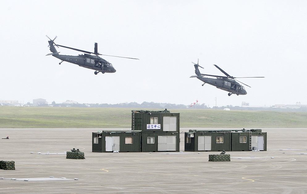 Taiwanese pilots fly American-made UH-60 Black Hawk helicopters over the annual Han Kuang war games. (Chiang Ying-ying/AP)