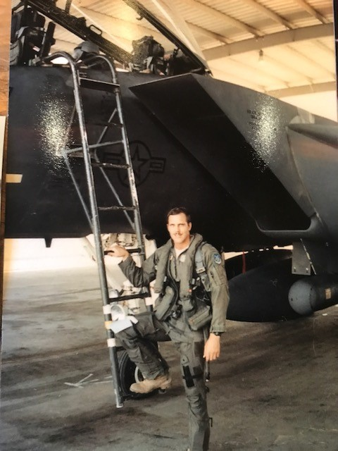 Luke Easter, who whose daughters are an Air Force Academy graduate and students at Annapolis and West Point, poses during his time piloting the F-15 Strike Eagle. (Easter family photo)
