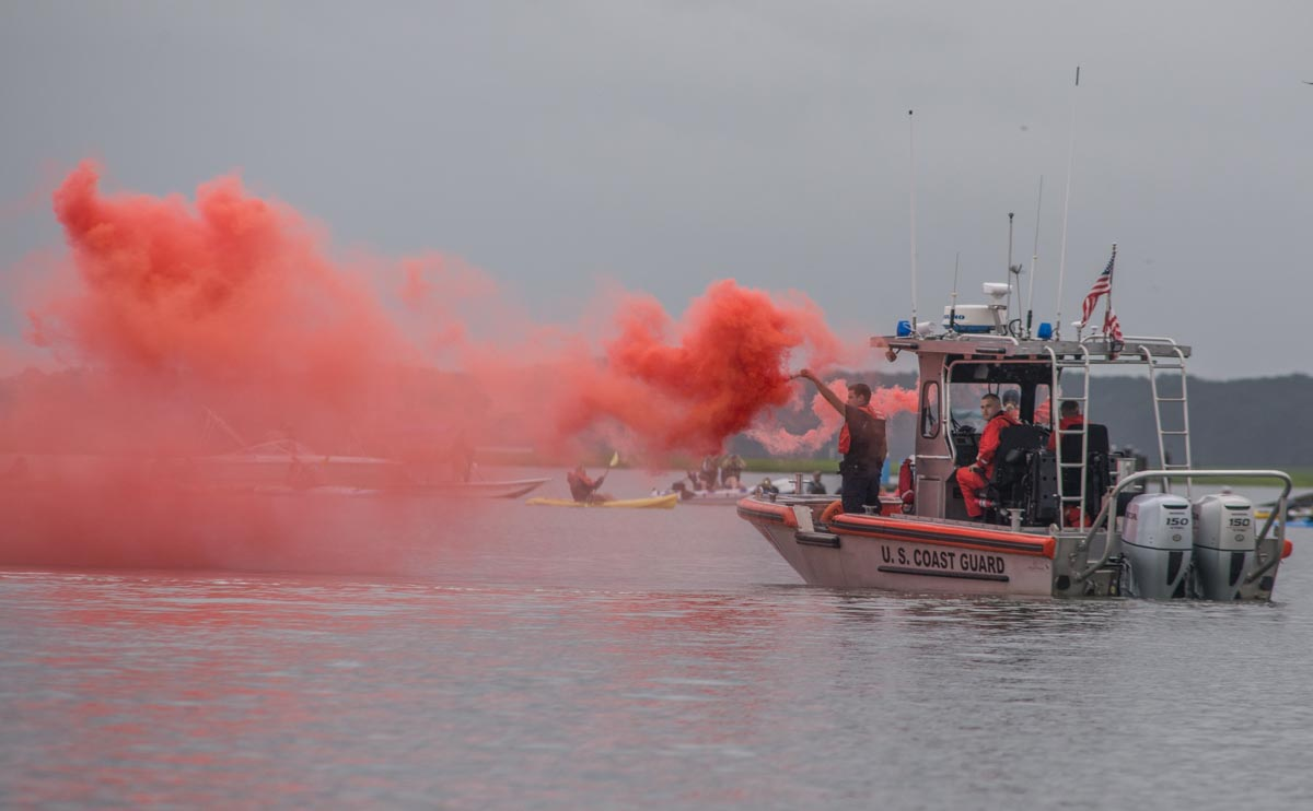 Chincoteague, Va. (July 25, 2018) Coast Guardsmen from Station Chincoteage use smoke to alert that the Chincoteague annual pony swim has begun. (photo by Mark D. Faram/Navy Times)