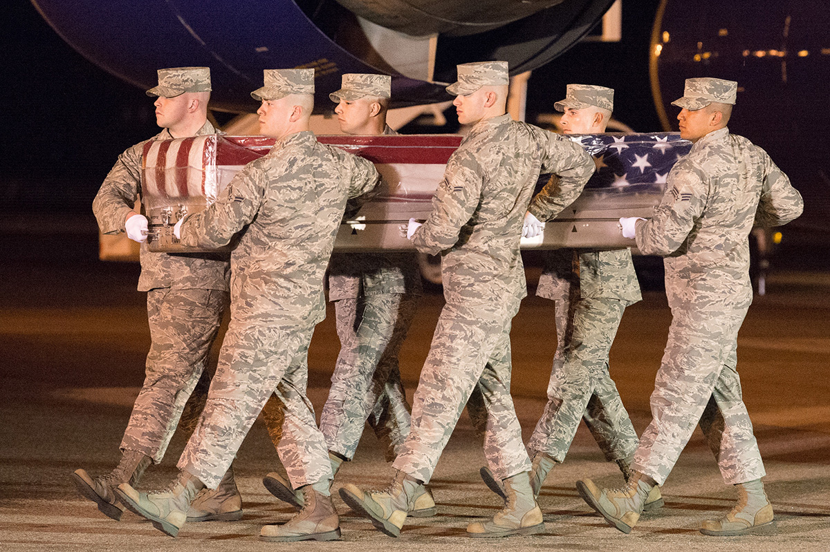 A U.S. Air Force carry team transfers the remains of Staff Sgt. Albert J. Miller, of Richmond, N.H., April 21, 2019, at Dover Air Force Base, Del. Miller was assigned to the 736th Aircraft Maintenance Squadron, Dover AFB. (Mauricio Campino/Air Force)