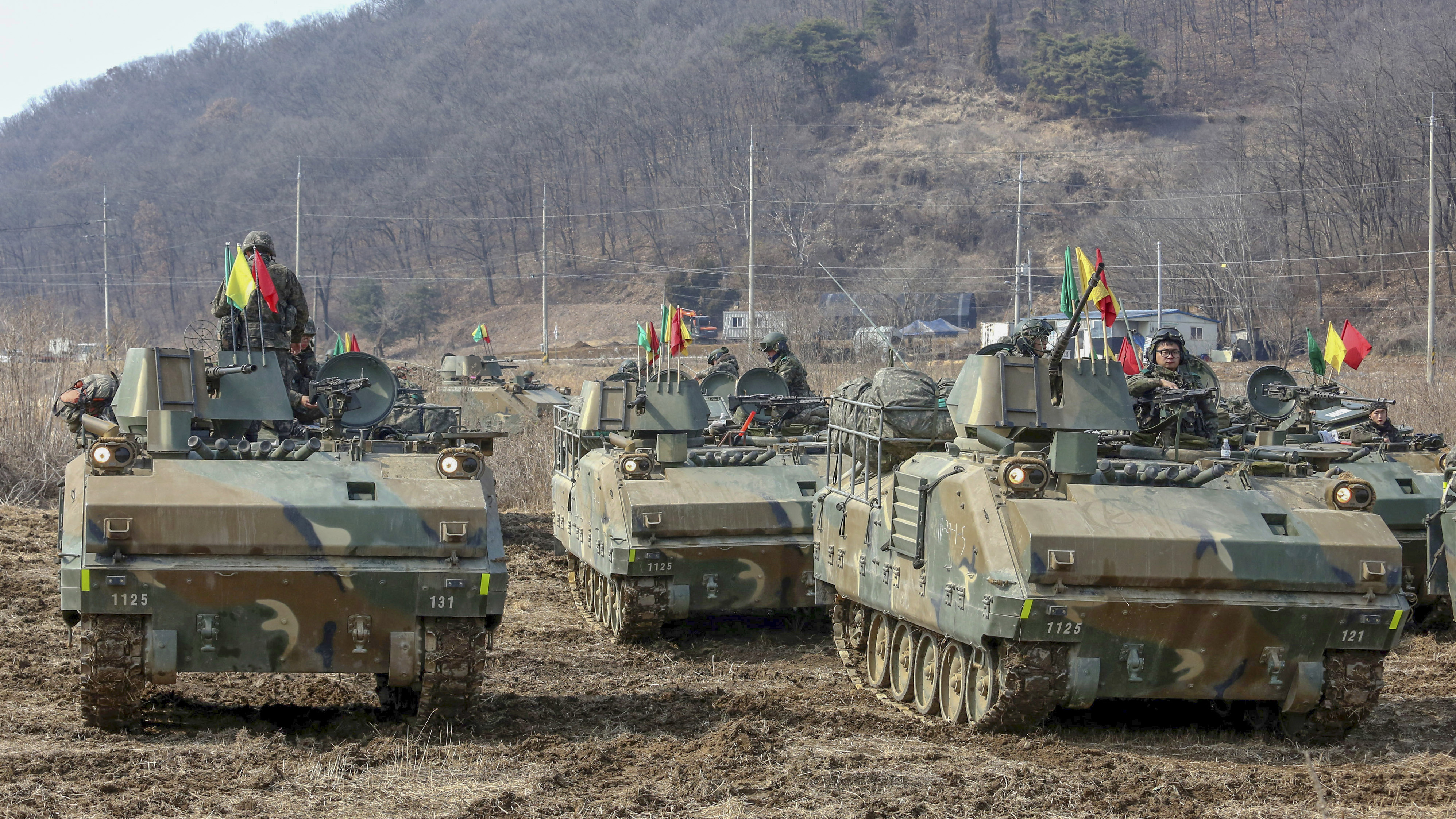 South Korean army soldiers participate in a military exercise in Yeoncheon, South Korea, near the border with North Korea, Wednesday, Feb. 27, 2019 during President Donald Trump's second meeting with North Korean leader Kim Jong Un aimed at getting Kim to give up nuclear weapons in exchange for relief from sanctions hobbling his economy and better relations with the U.S. and other nations. (AP Photo/Ahn Young-joon)