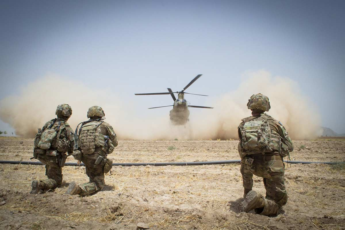 Paratroopers secure a helicopter landing zone for a CH-47 Chinook helicopter, July 20, 2019, in Kandahar Province, Afghanistan. (Maj. Thomas Cieslak/Army)