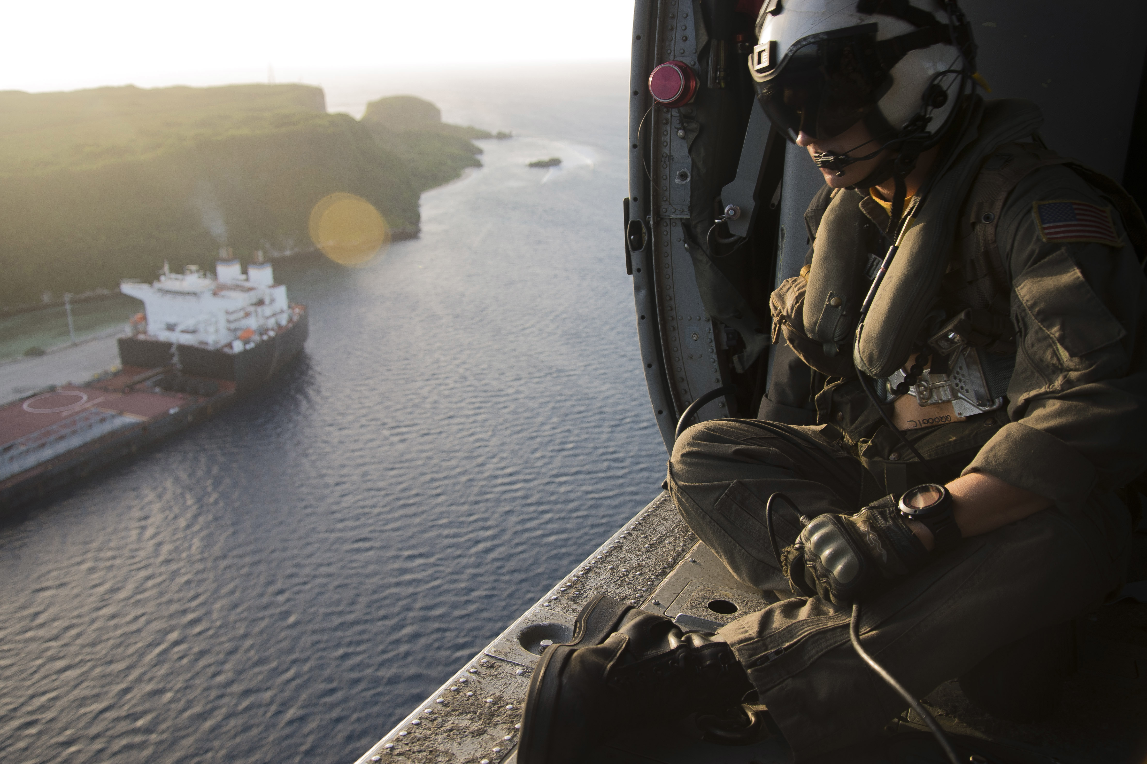 U.S. Navy Naval Aircrewman (Helicopter) 1st Class John McCracken, assigned to Helicopter Sea Combat Squadron (HSC) 25, assists on overwatch during a Maritime Close Air Support Scenario with U.S. Marines in Guam. (Chief Mass Communication Specialist Joan E. Jennings/Navy)