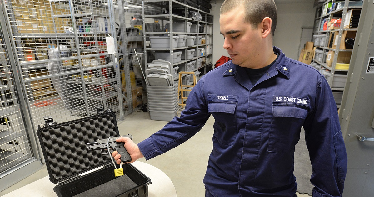 There are plenty of options, and plenty of regulations, for service members to keep in mind when transporting their personal firearms. Here, Coast Guard Petty Officer 3rd Class Jacob Tyrell displays a locked handgun and carrying case. (PO1 Shawn Eggert/Coast Guard)