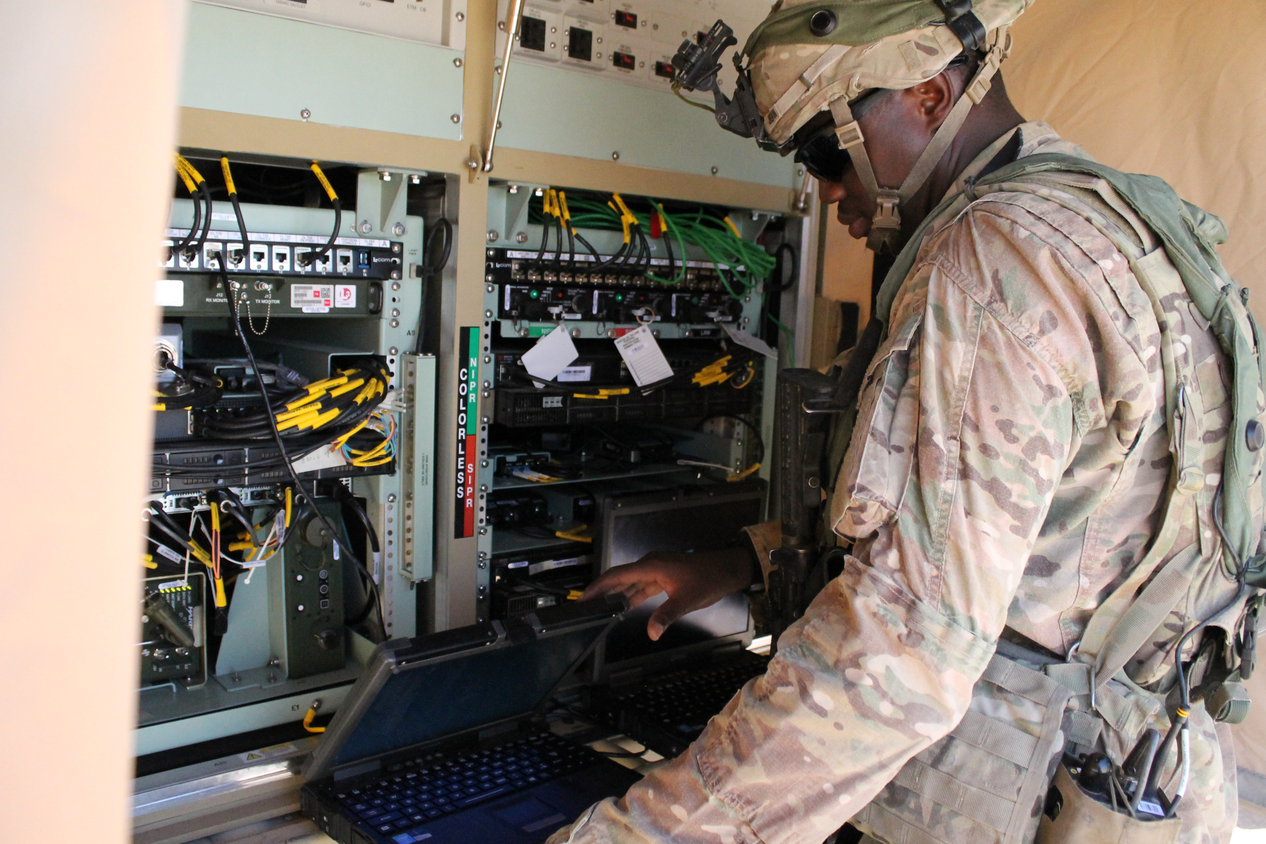 The TCN-L, now in a Humvee, can provide network connectivity on the move, and now consists of one flat panel at waist-level for easy access to the servers. Most of the equipment is now virtualized so it saves space and the air-conditioning to keep the system cool doesn't have to push as hard so overheating isn't as much of an issue, even in the desert in July. (Jen Judson/Staff)