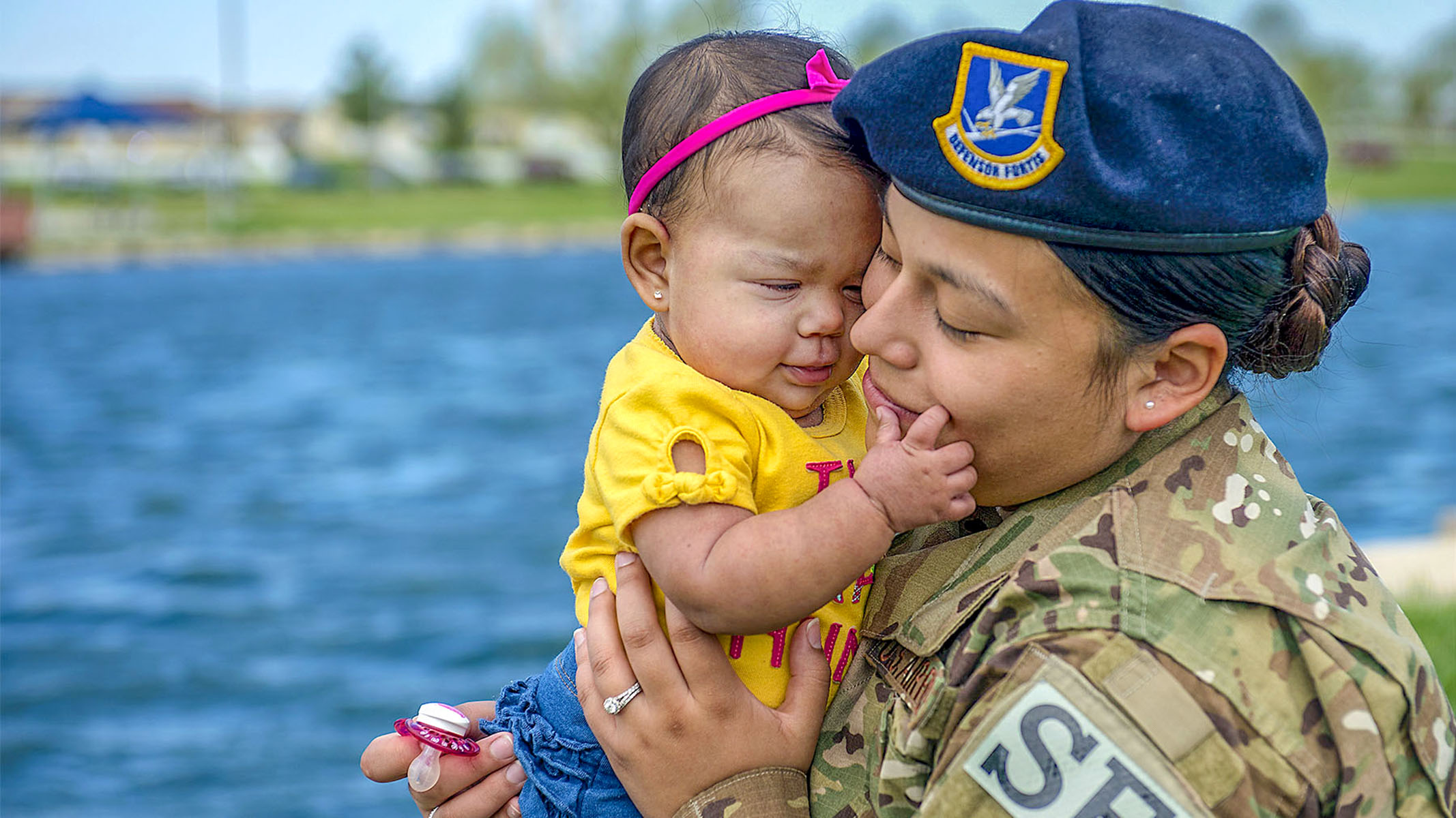 Air Force Senior Airman Ashley Dudley plays with her 8-month old daughter at Whiteman Air Force Base, Mo., May 4, 2018. Dudley is assigned to the 509th Security Forces Squadron. (A1C Taylor Phifer/Air Force)