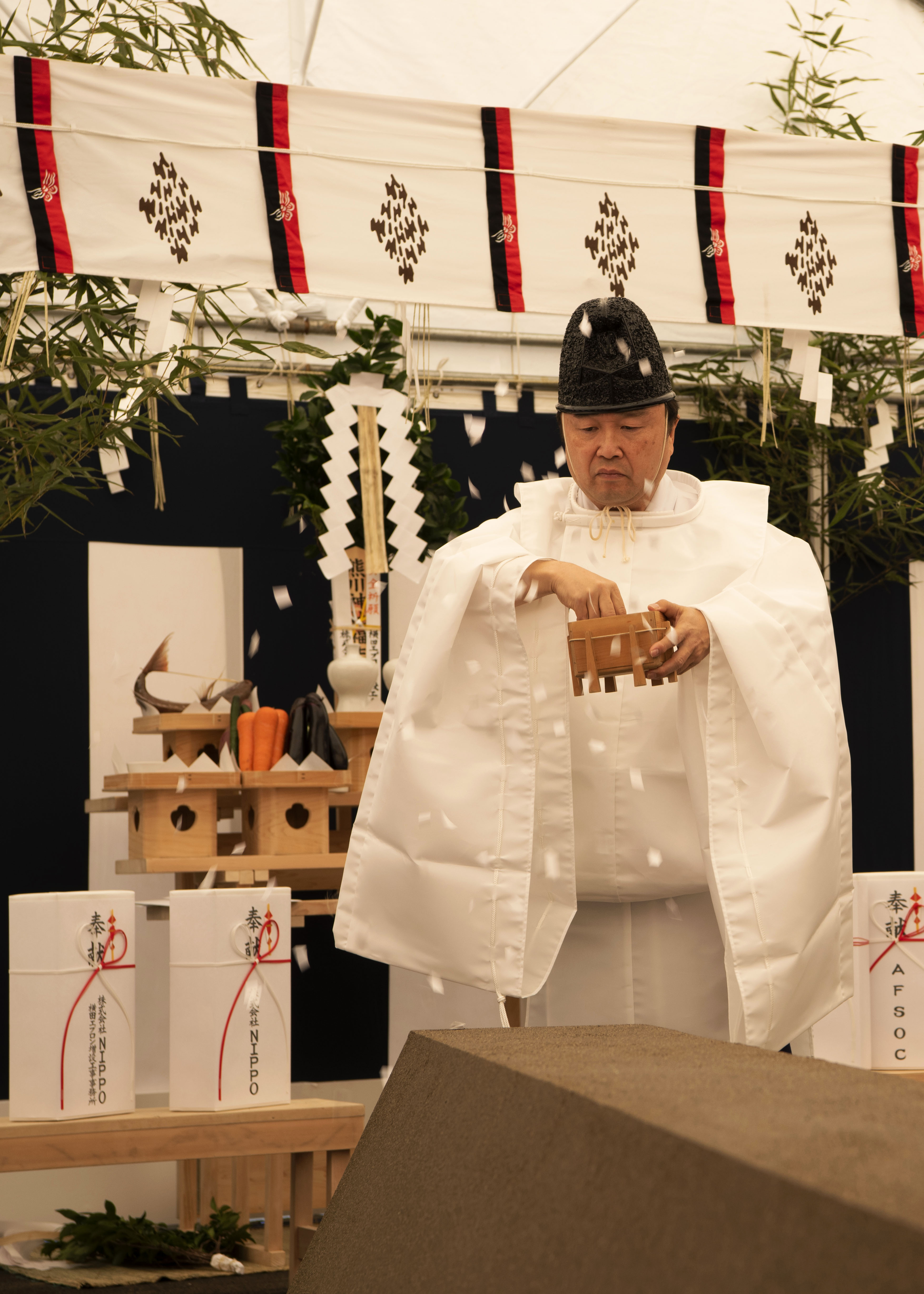 A Shinto priest performs a prayer recital to purify the land during the Air Force Special Operations Command airfield apron ground breaking ceremony held at Yokota Air Base, Japan, Dec. 5, 2019. The prayers and offerings are part of a traditional Shinto tradition to purify the site and wish safety on the construction crew. (Staff Sgt. Taylor Workman/Air Force)
