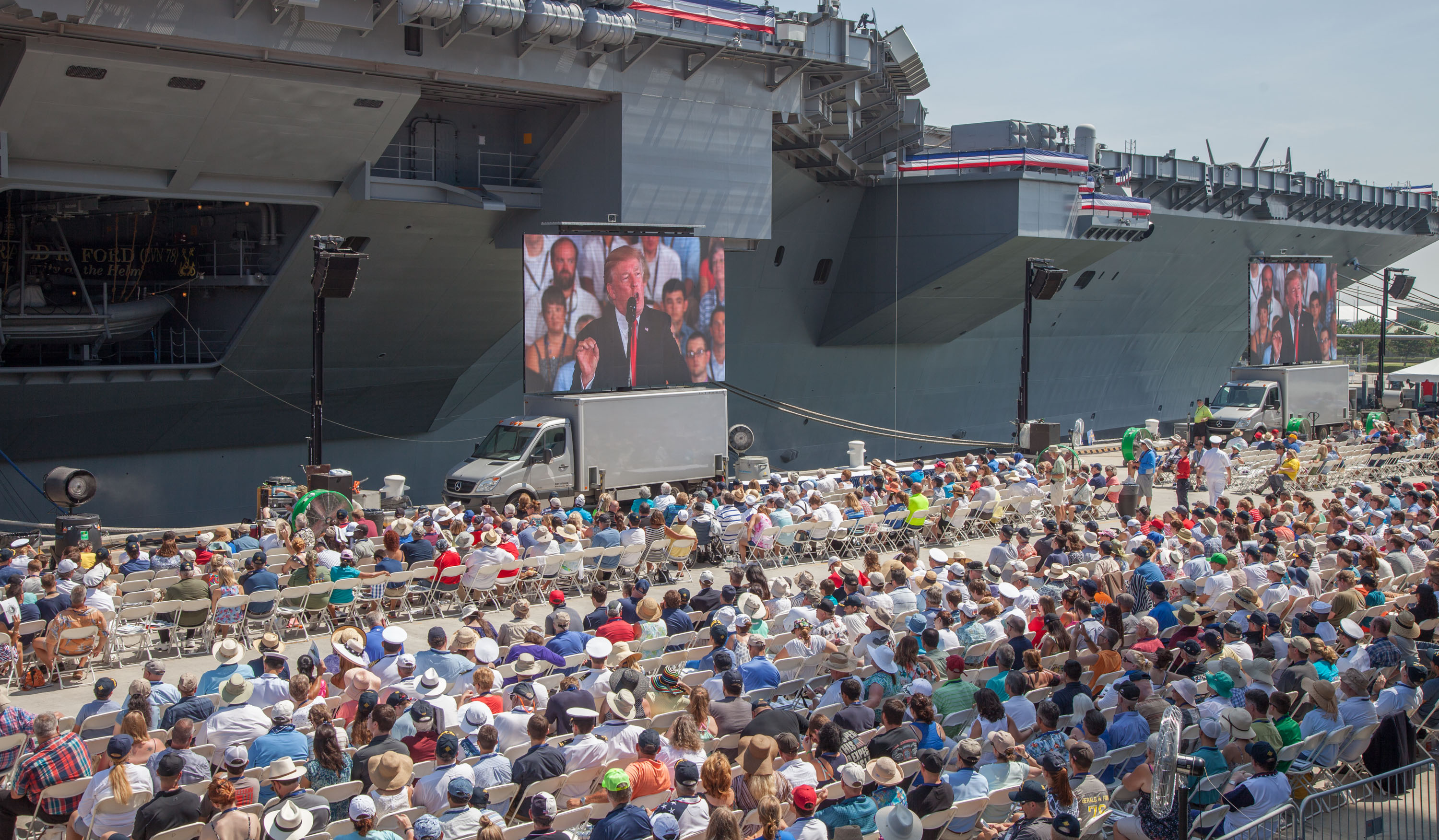 President Donald Trump gives the keynote address at the commissioning of the aircraft carrier Gerald R. Ford and is watched by thousands of spectators on Pier 11 at Norfolk Naval Station.