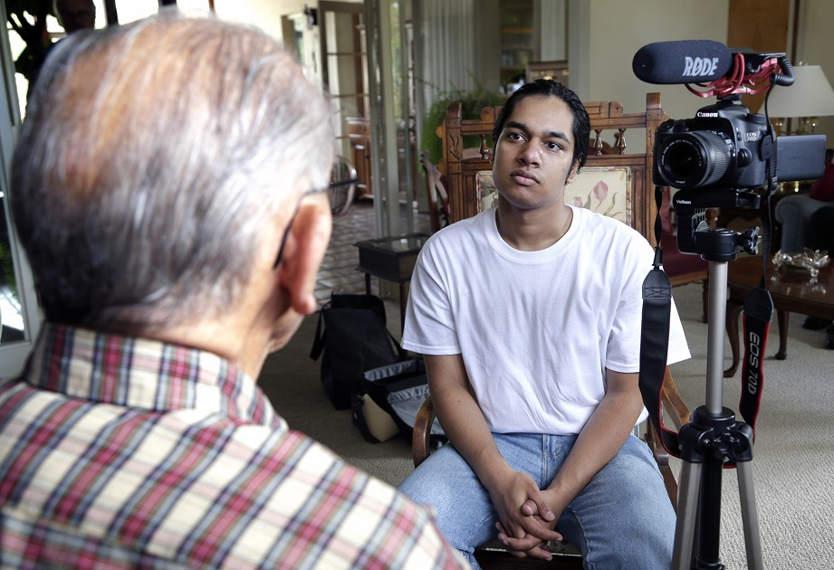 Rishi Sharma interviews World War II veteran William Hahn at his home in Los Angeles on Oct. 17, 2016. Sharma's heroes aren't sports or movie stars or any other kind of stars; they're the U.S. combat veterans who won World War II. (Nick Ut/AP)
