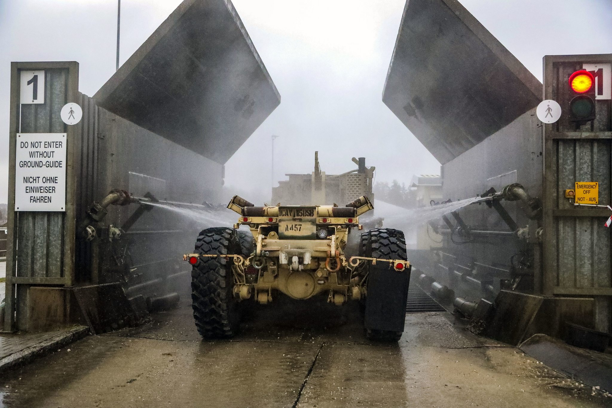 A soldier mans his vehicles as it is cleaned in the wash rack at Camp Aachen in Grafenwoehr, Germany Jan. 7, 2019. (Staff Sgt. Ron Lee/Army National Guard)