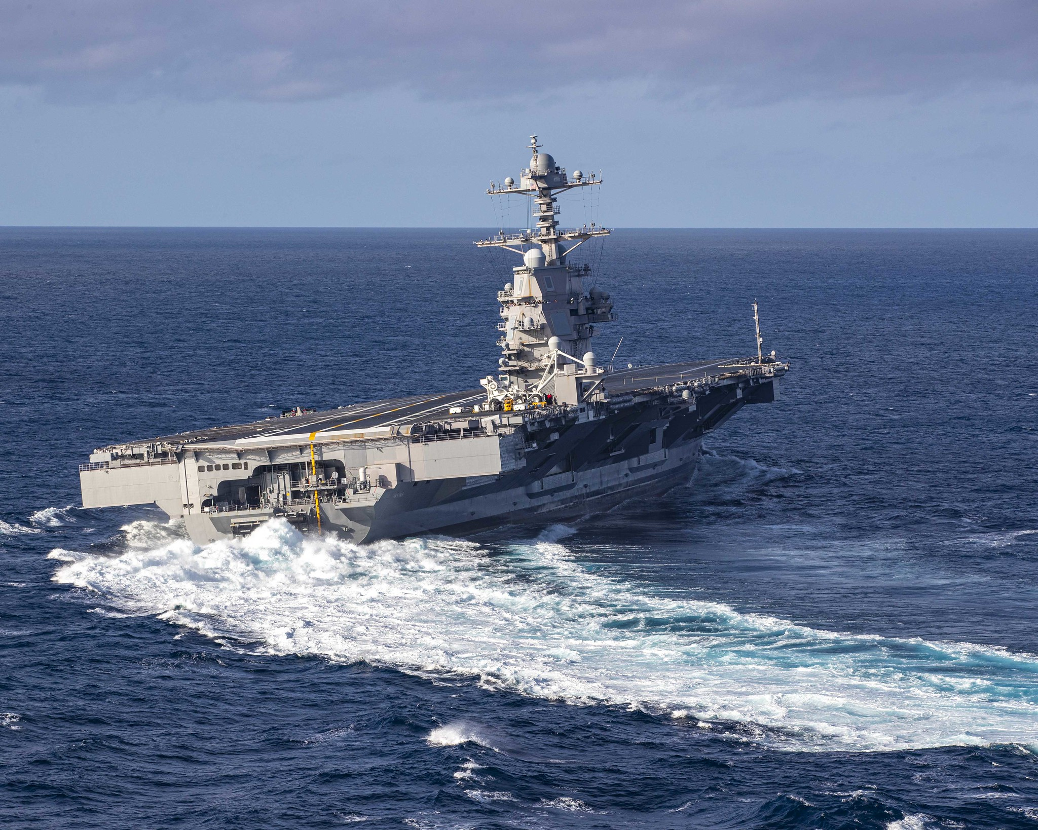 The aircraft carrier USS Gerald R. Ford (CVN 78) conducts high-speed turns in the Atlantic Ocean, Oct. 29, 2019. Gerald R. Ford is at sea conducting sea trials following the in port portion of its 15-month post-shakedown availability. (Mass Communication Specialist 3rd Class Connor Loessin/Navy)