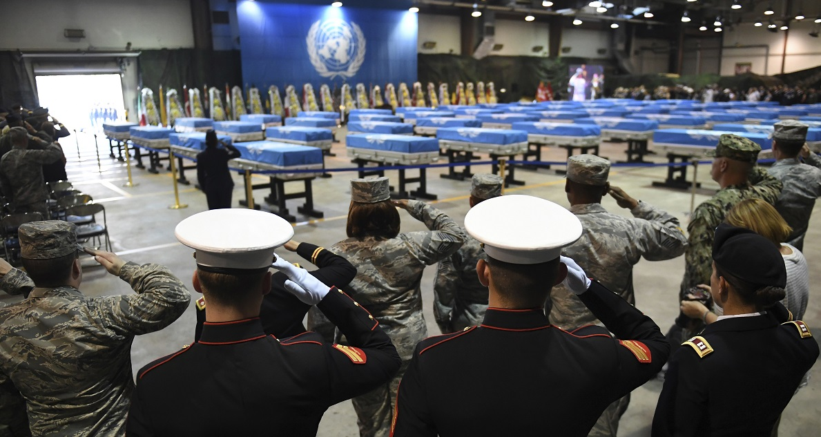 U.S. troops salute during a repatriation ceremony for the remains of U.S. service members killed in the Korean War and collected in North Korea, at the Osan Air Base in Pyeongtaek, South Korea, Wednesday, Aug. 1, 2018. North Korea handed over 55 boxes of the remains last week as part of agreements reached during a historic June summit between its leader Kim Jong Un and U.S. President Donald Trump. (Jung Yeon-je/Pool Photo via AP)