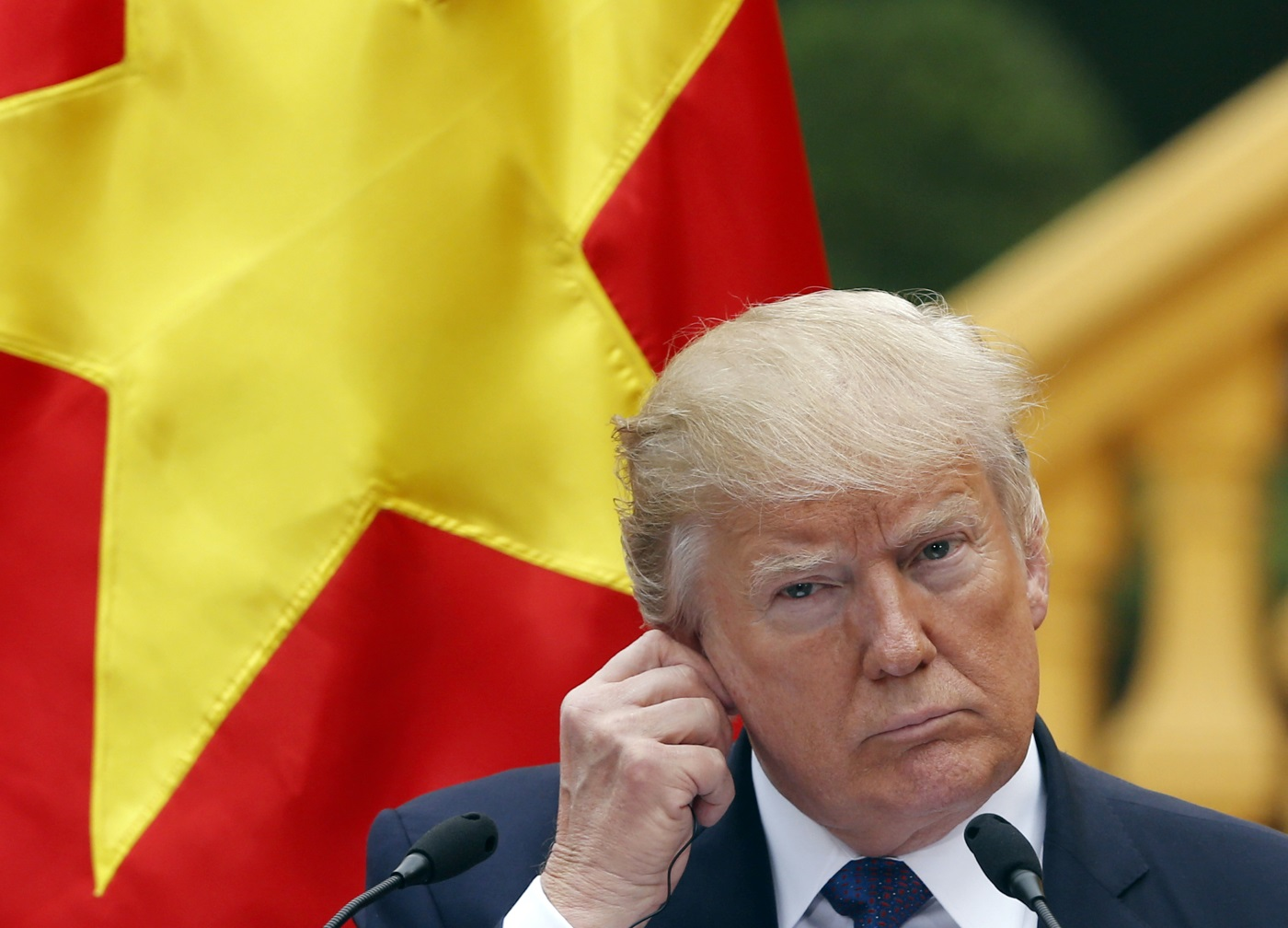 U.S. President Donald Trump attends a press conference at the Presidential Palace in Hanoi, Vietnam, Sunday, Nov. 12, 2017. (Kham/Pool Photo via AP)