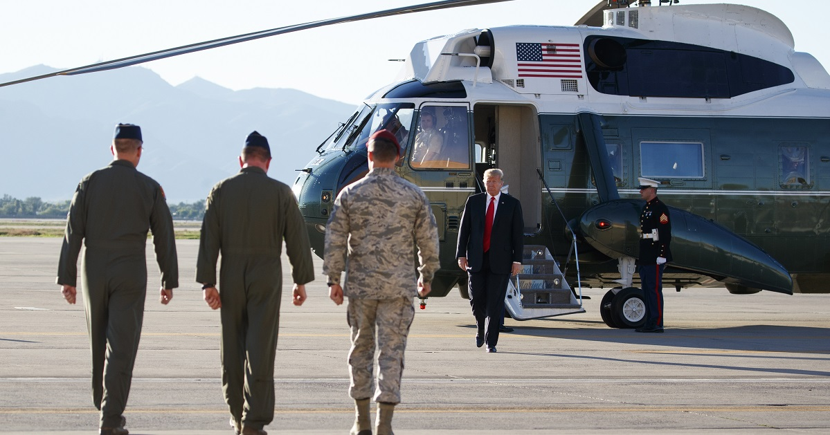 President Donald Trump walks from Marine One as he arrives at Luke Air Force Base, Ariz., Friday for a Defense Capability Tour. (Carolyn Kaster/AP)