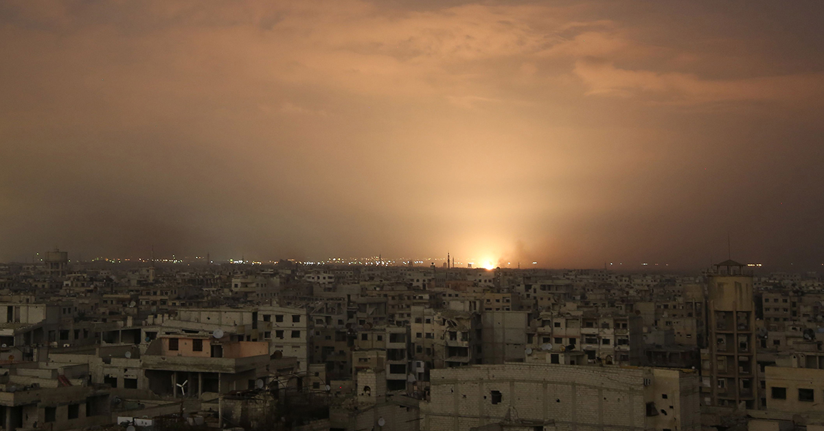 Smoke billows following a regime air strike on the besieged Eastern Ghouta region on the outskirts of the capital Damascus, late on Feb. 23, 2018. Syrian regime air strikes and artillery fire hit the rebel-held enclave of Eastern Ghouta for a sixth straight day killing 32 civilians, as the world struggled to reach a deal to stop the carnage. (Ammar Suleiman/AFP/Getty Images)