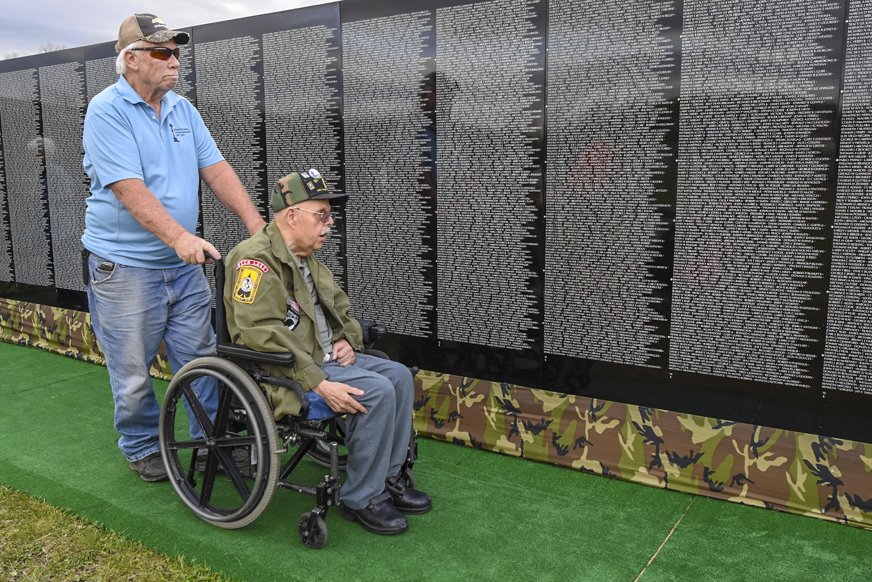 Navy veteran Kermit Snyder, left, and Army veteran John A. Koch view The Moving Wall Vietnam Veterans Memorial at Island Park in Schuylkill Haven, Pennsylvania. (Jacqueline Dormer/The Republican-Herald via AP)
