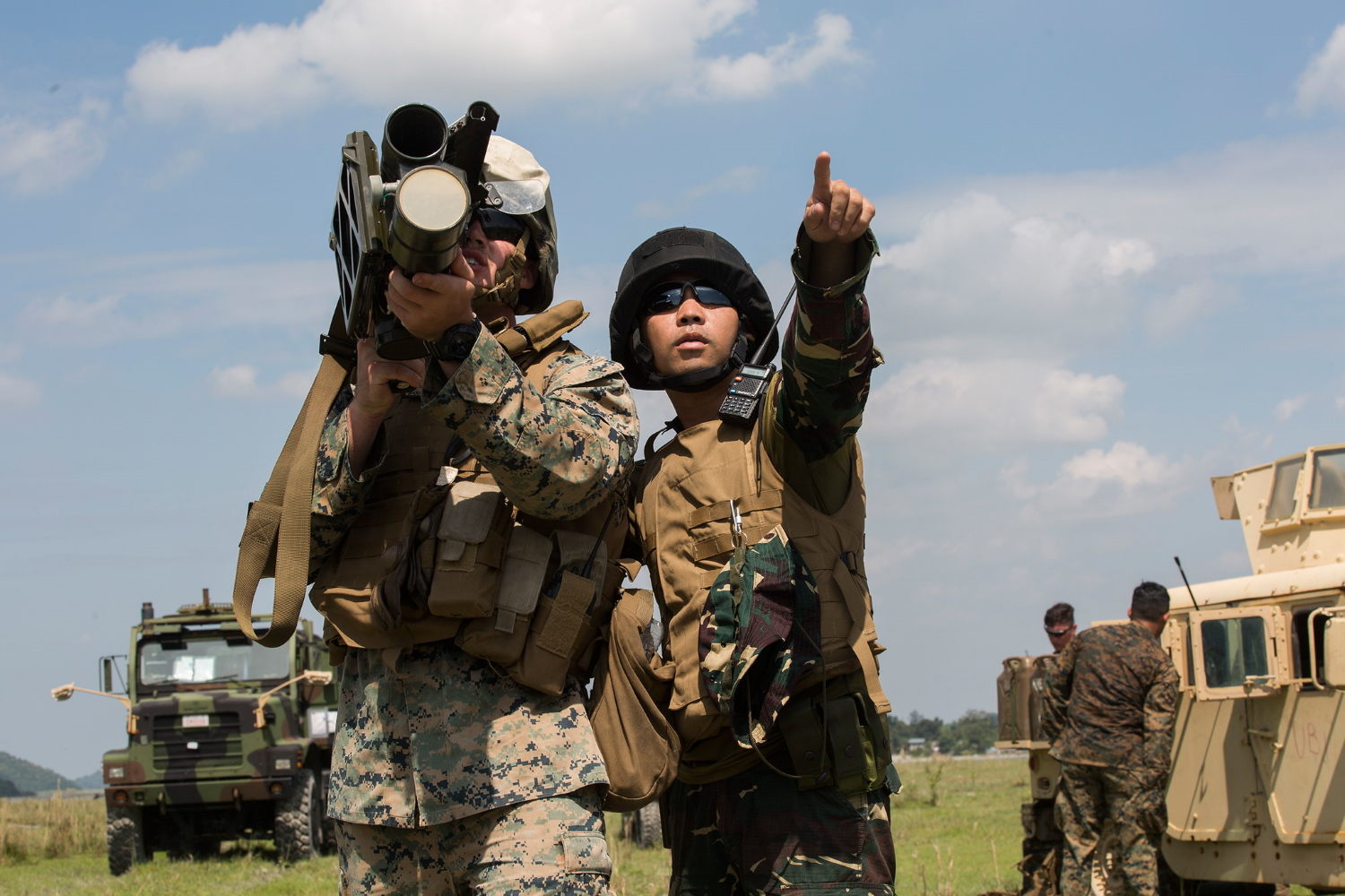 Philippine Airman 2nd Class Carlos P. Elamparo acts as a gunner for U.S. Marine Lance Cpl. Callen Shouse during a surface-to-air missile simulation as part of exercise KAMANDAG 3 at Colonel Ernesto P. Ravina Air Base, Philippines, Oct. 10, 2019. (Lance Cpl. Brienna Tuck/Marine Corps)