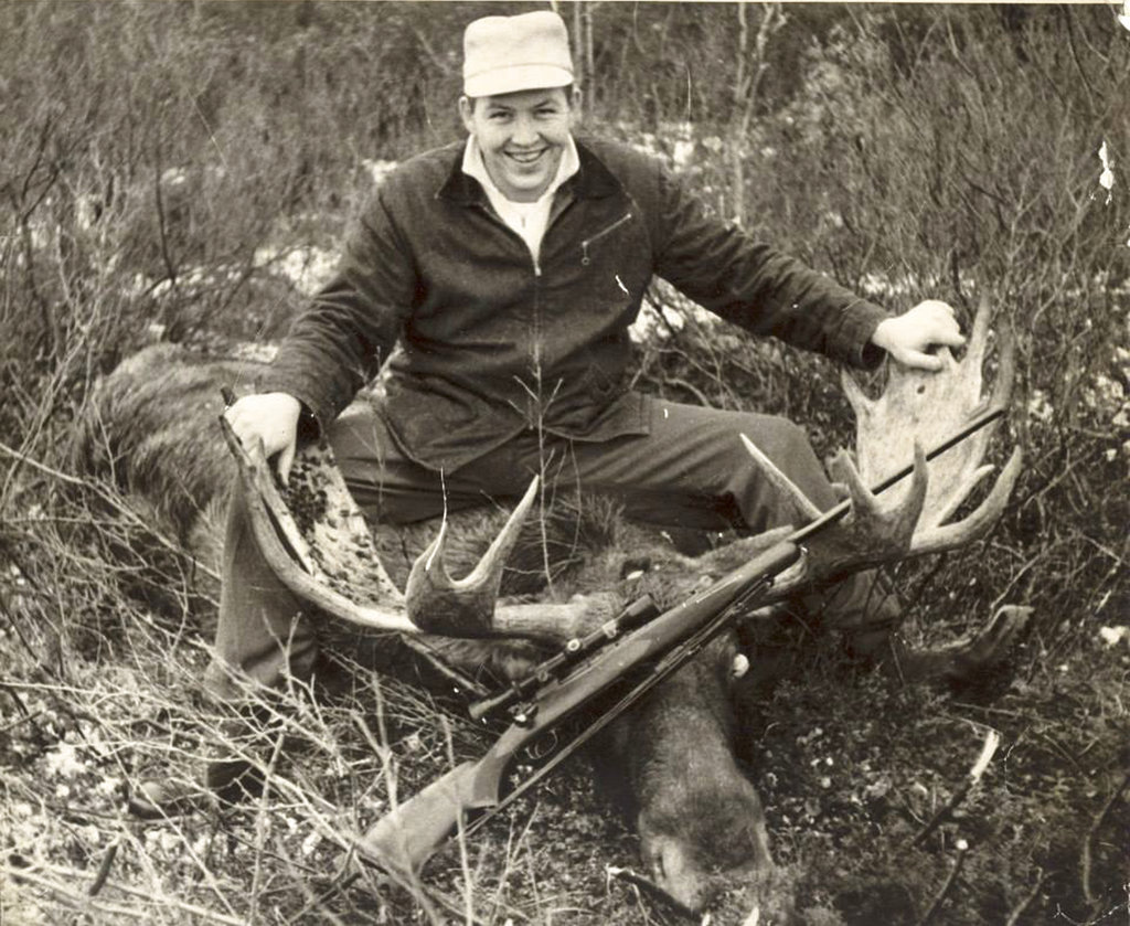 This photo provided by Kenneth Ayers Jr. and taken in 1960 shows his father, Kenneth Ayers Sr., after a successful moose hunt in Alaska. (Photo courtesy Kenneth Ayers Jr. via AP)