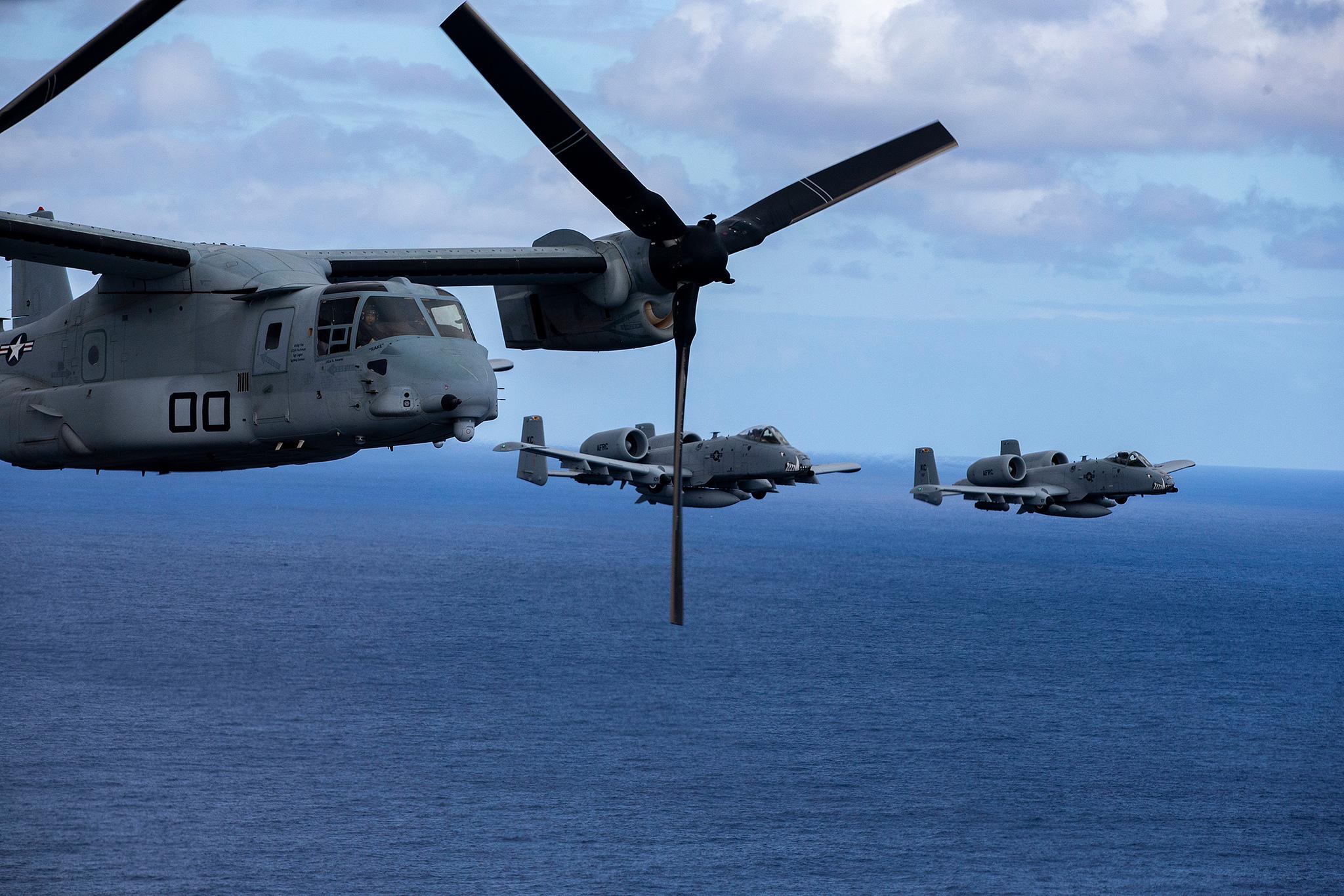 Air Force A-10 Thunderbolt II aircraft escort an MV-22B Osprey in Hawaii on Feb. 26, 2019. (Sgt. Alex Kouns/Marine Corps)