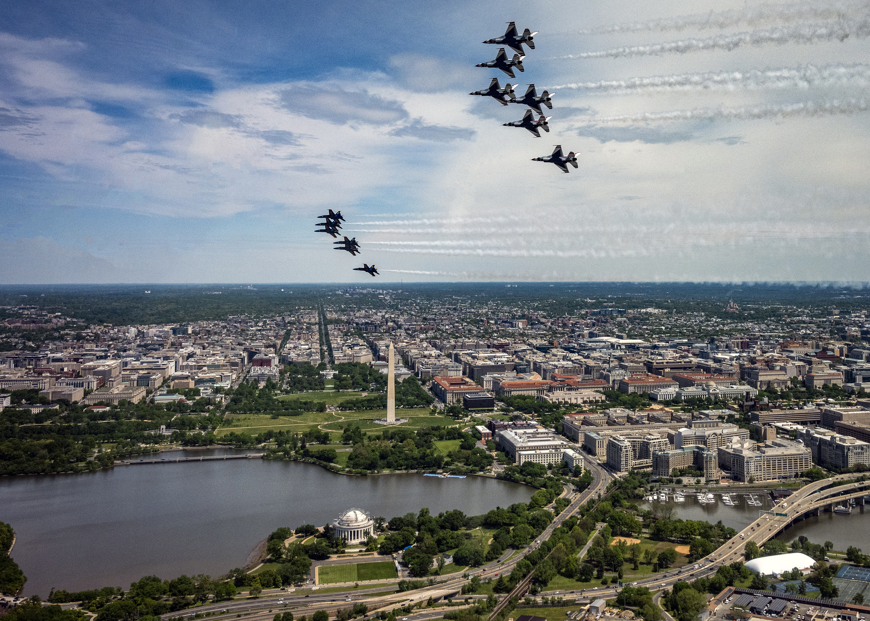"The U.S. Air Force Air Demonstration Squadron, the ""Thunderbirds,"" fly over Washington on May 2, 2020. The flyover was part of America Strong, a collaborative salute from the Air Force and Navy to recognize health care workers, first responders, military, and other essential personnel while standing in solidarity with all Americans during the COVID-19 pandemic. (Tech. Sgt. Ned T. Johnston/Air Force)"