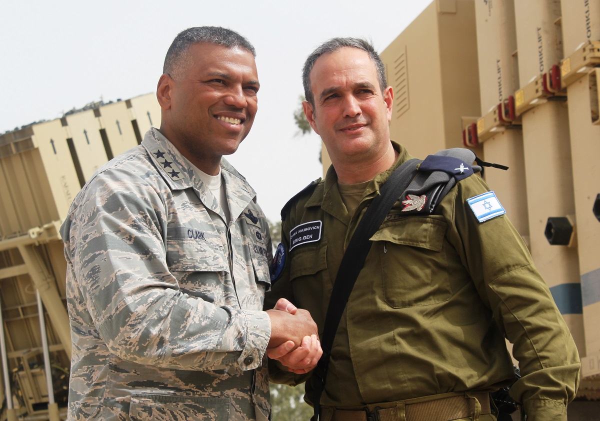The commander of 3rd Air Force, U.S. Air Force Lt. Gen. Richard Clark, left, and chief of the Israeli Air Defense Command, Brig. Gen. Zika Haimovich, shake hands at a press briefing in Israel on March 8, 2018. (Ben Hartman/Contributor)