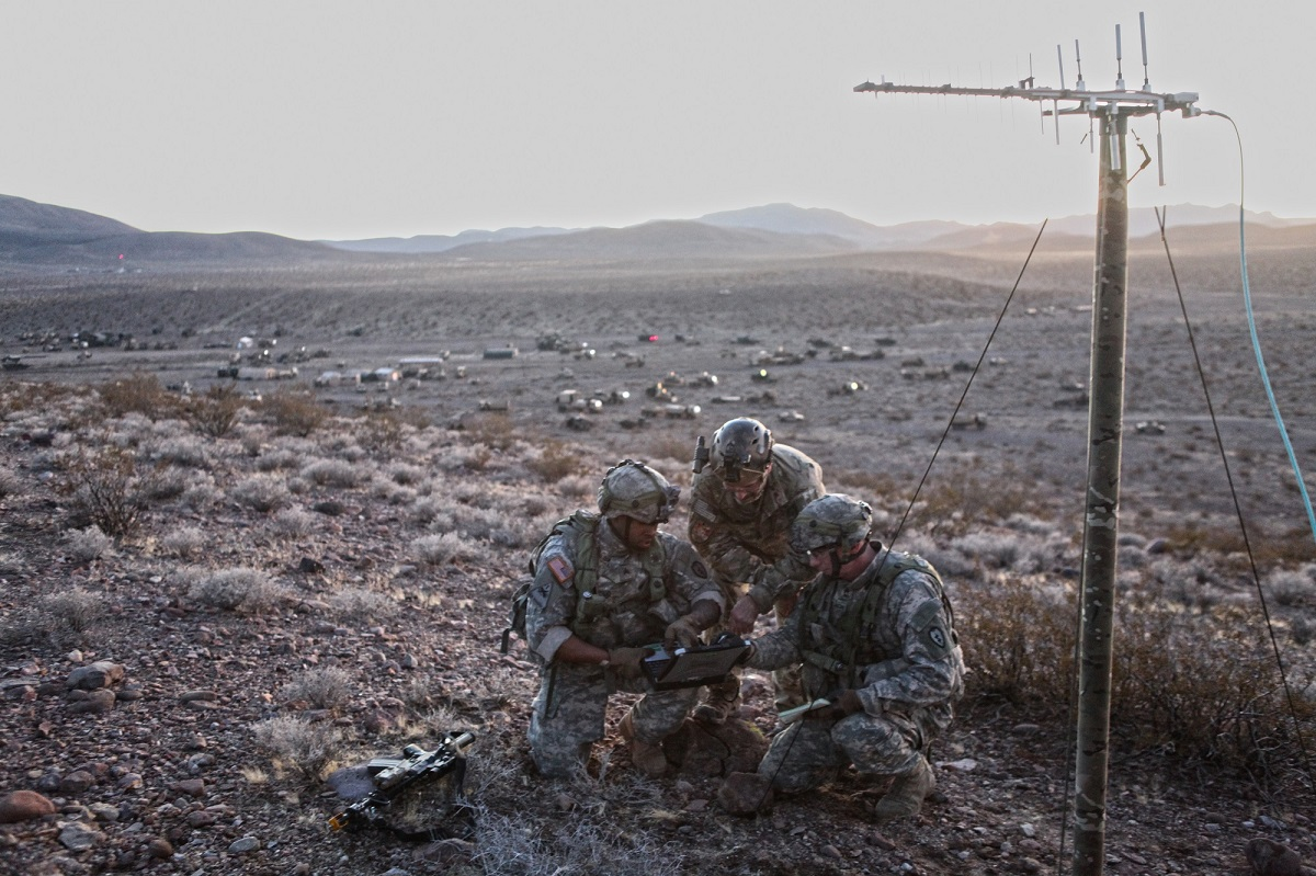 US. Army soldiers Sgt. Devon Cloud and Sgt. First Class Joseph Wambach, members of the 1st Stryker Brigade Combat Team, 25th Infantry Division Tactical Electronic Warfare (EW) Team and founding members of the northern-most chapter of the