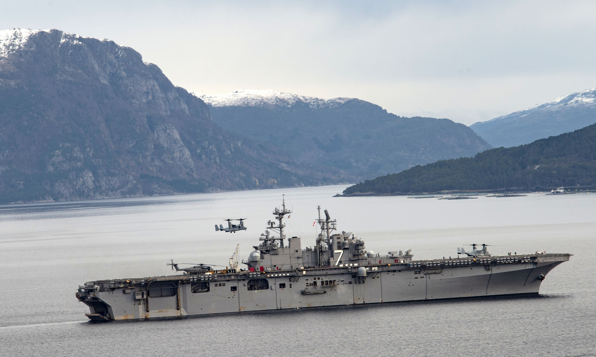 The Wasp-class amphibious assault ship USS Iwo Jima (LHD 7) transits the Alvund Fjord, Oct. 31, 2018, while participating in Trident Juncture 2018, a NATO-led exercise designed to certify NATO response forces and develop interoperability among participating NATO-allied and partner nations. (MC3 Joe J. Cardona Gonzalez/Navy)