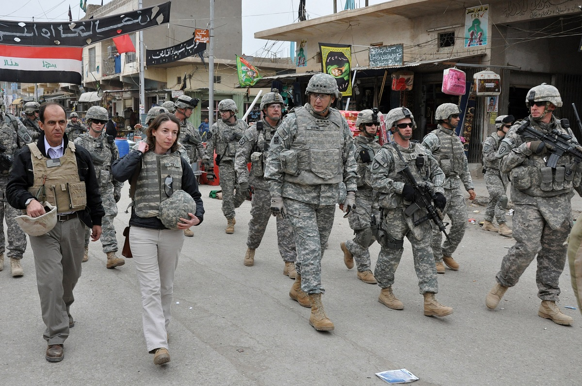 Gen. Ray Odierno walks with soldiers through a market in Khalis, Iraq, in 2009. Later, as Army chief of staff, Odierno ordered a detailed history of the war. (Spc. Kimberly Millett/Army)