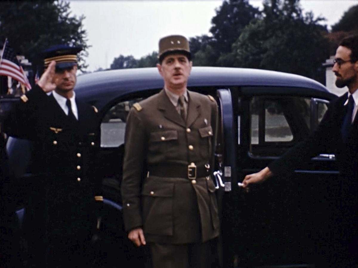 Charles de Gaulle, arrives for a military parade down the Champs-Elysees after the liberation of Paris. Seventy-five years later, surprising color images of the D-Day invasion and aftermath bring an immediacy to wartime memories. They were filmed by Hollywood director George Stevens and rediscovered years after his death. (War Footage From the George Stevens Collection at the Library of Congress via AP)