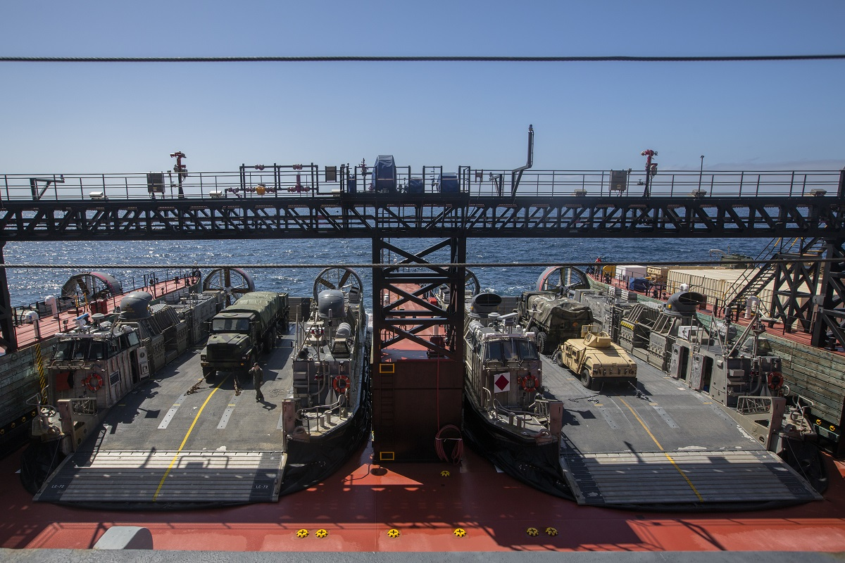 In conjunction with U.S. Merchant Marines, 1st Truck Support Battalion rehearses the offloading of vehicles during a skin-to-skin maneuver. (Lance Cpl. Danny Gonzalez/U.S. Marine Corps)