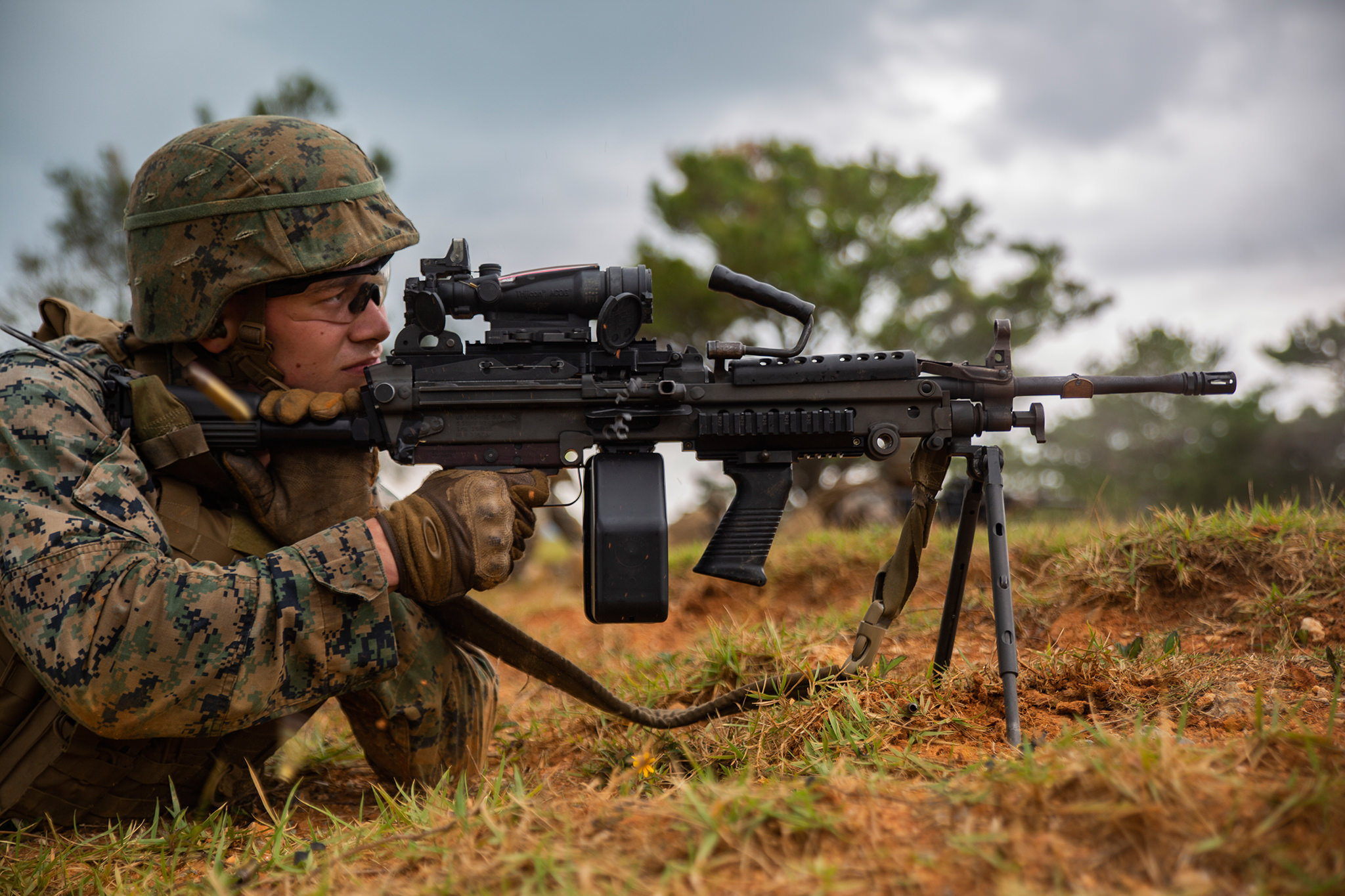Cpl. Daniel Divirgilio fires a M249 Light Machine Gun at a target Oct. 24, 2018, during a fire and movement range at Camp Hansen, Okinawa, Japan. (Lance Cpl. Terry Wong/Marine Corps)
