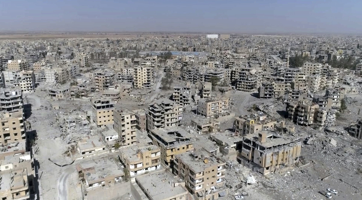 This Oct. 19, 2017, file photo, a frame grab made from drone video shows damaged buildings in Raqqa, Syria. (Gabriel Chaim/AP)