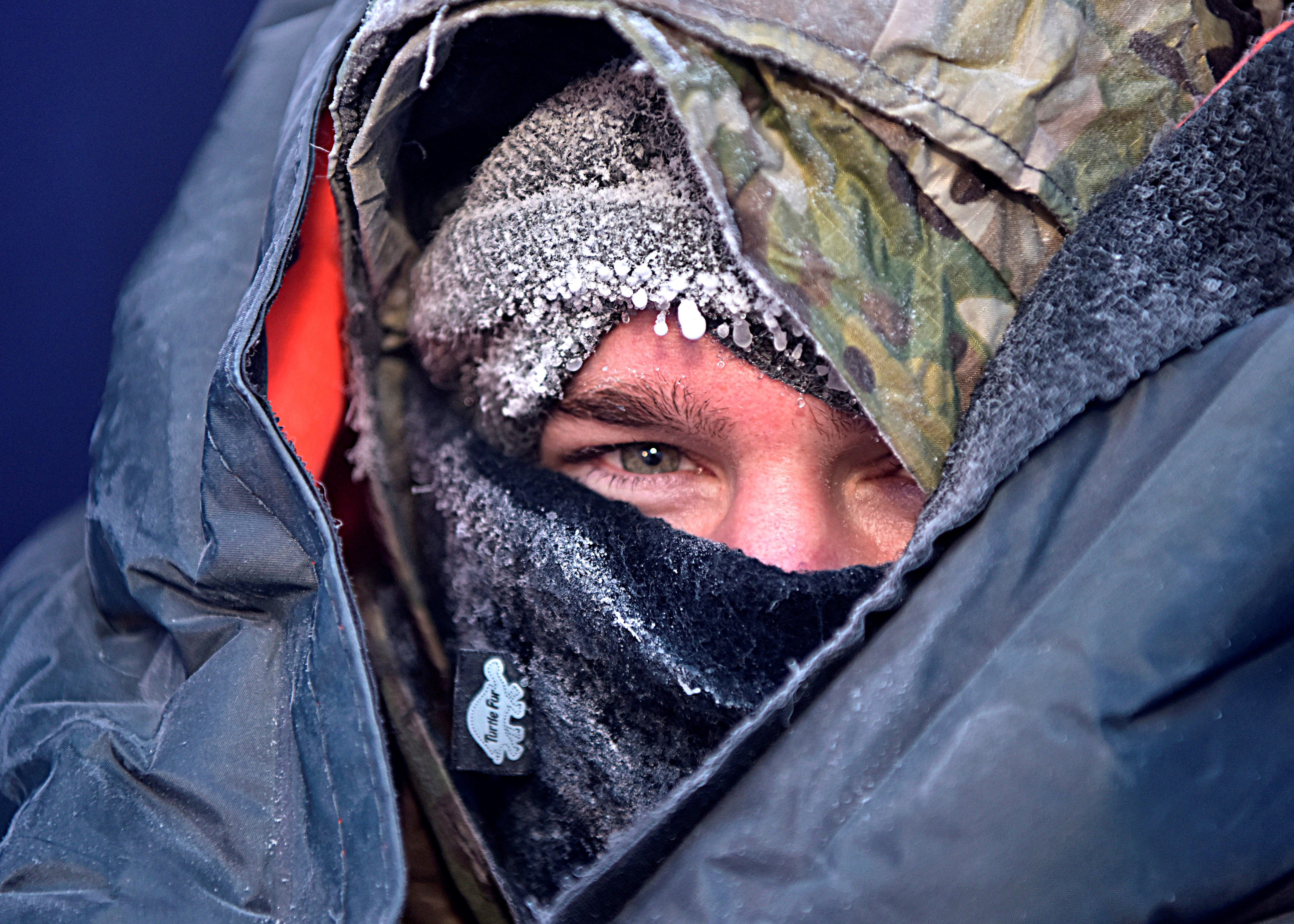 Staff Sgt. Zachary Rumke, 66th Training Squadron Detachment 1 Arctic Survival School instructor, tests an F-35A Lightning II survival-gear kit in Fairbanks, Alaska, Nov. 5, 2019. Rumke sat in minus 65 degree temperatures for six hours to test the new gear that could be used to protect F-35 pilots from subzero temperatures in the event of an ejection. (Senior Airman Beaux Hebert/Air Force)
