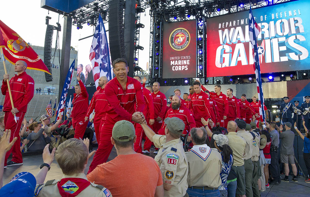 Team Marine Corp greets the crowd during the opening ceremony of the DoD Warrior Games, June 2, 2018. The Warrior Games, taking place June 1-9, 2018, at the U.S. Air Force Academy in Colorado, are Paralympic-style competition for wounded, and injured service members from all U.S. branches of service and this year include teams from the United Kingdom Armed Forces, Australian Defence Force and Canadian Armed Forces. (Master Sgt. Stephen D. Schester/DoD)