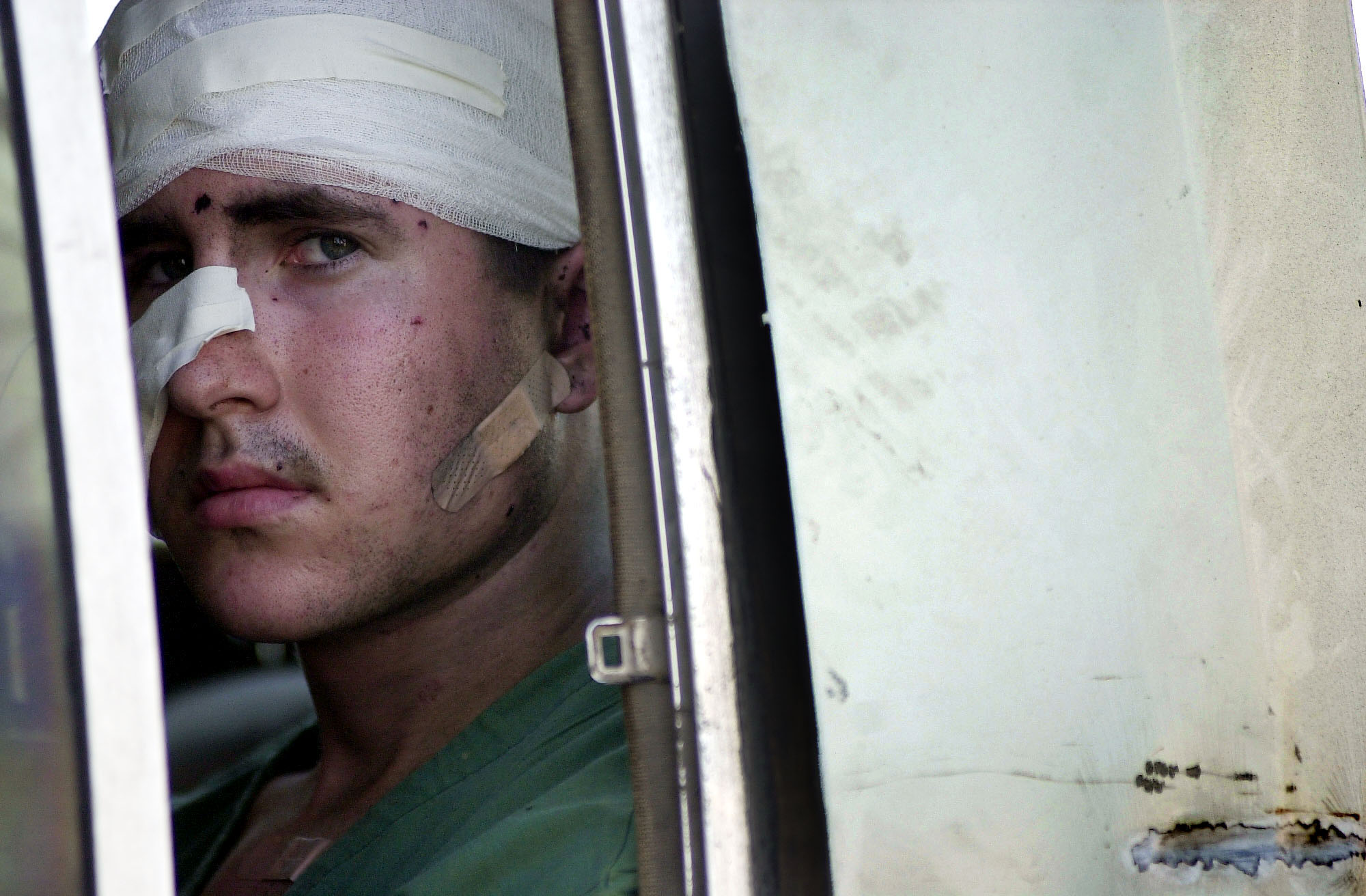 A wounded American sailor from the USS Cole departs a Yemeni hospital October 12, 2000 en route to additional medical treatment in Germany following the terrorist bombing attack on his ship in the port of Aden, Yemen. (Photo by Jim Watson/Navy/)
