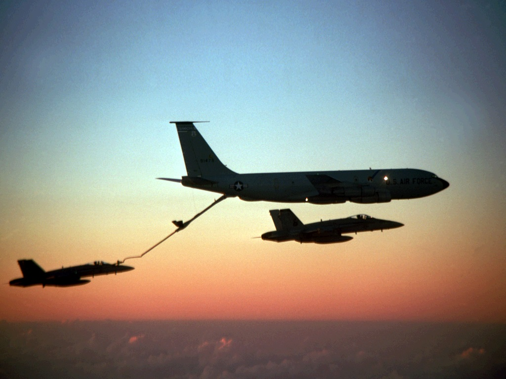 A KC-135 Stratotanker refuels an F-15 Eagle midflight. Fairchild Air Force Base has been selected to receive 12 additional Stratotankers, and will reactivate a squadron to operate them. (Air Force)