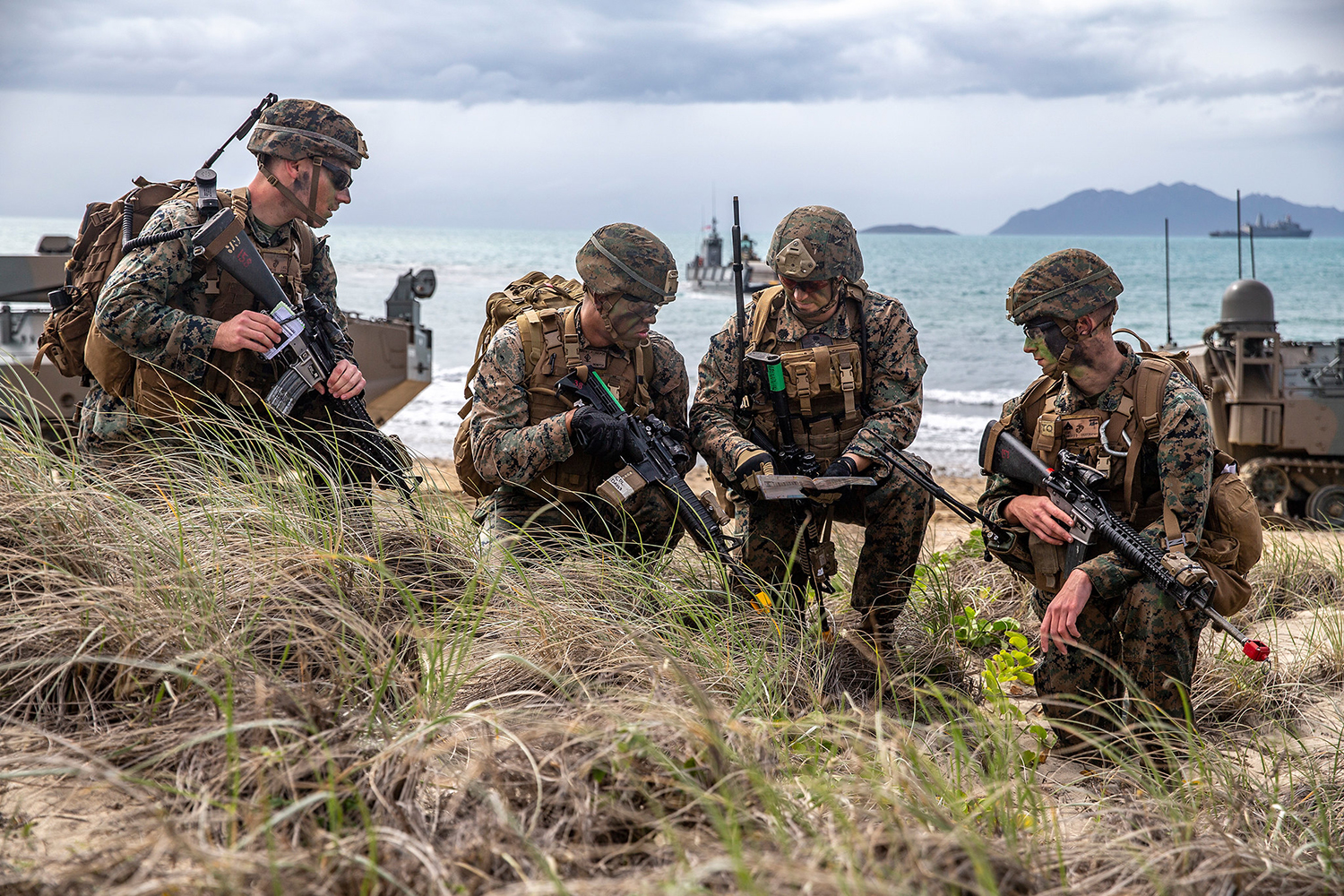 U.S. Marines assess a terrain map during a simulated amphibious assault of exercise Talisman Sabre 19 in Bowen, Australia, July 22, 2019. (Lance Cpl. Tanner D. Lambert/Marine Corps)