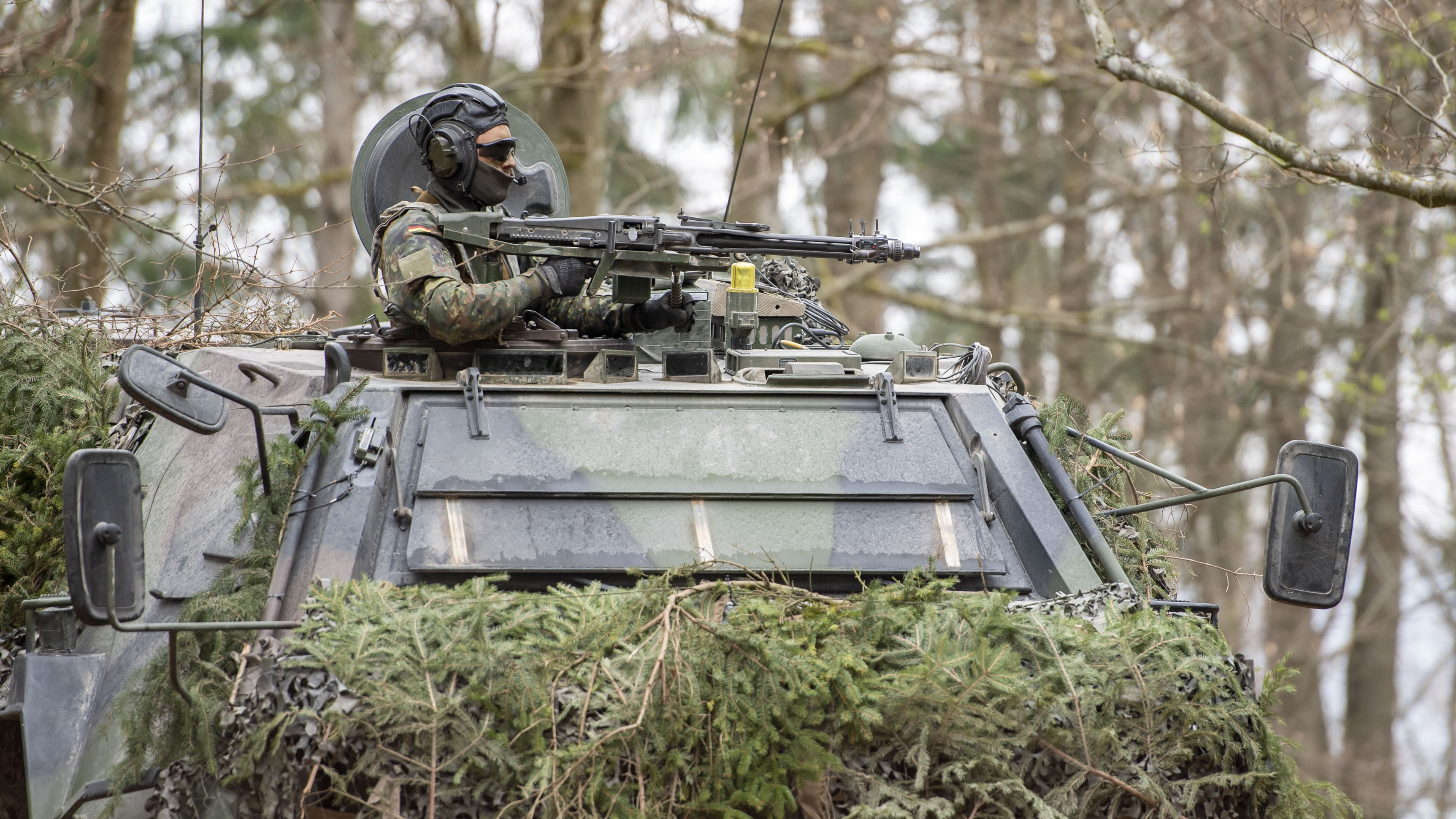 A soldier of the German Bundeswehr secures a Tactical Operations Center during the Allied Spirit X international military exercises at the U.S. 7th Army training center on April 9, 2019 near Hohenfels, Germany. Approximately 5,600 soldiers, including around 1,300 from the U.S. and the rest from Denmark, Finland, Germany, Israel, Italy, Lithuania, Moldova, Netherlands, Poland, Slovakia, Spain, Sweden, Turkey, and the United Kingdom are taking part in the nearly three-week long exercises. (Photo by Lennart Preiss/Getty Images)