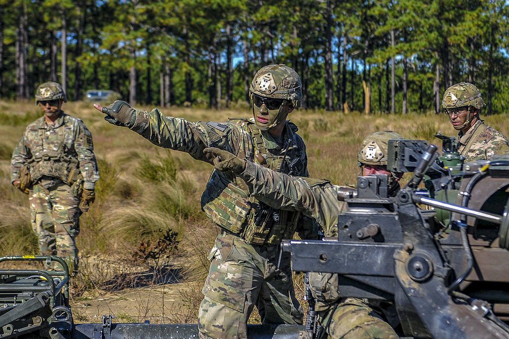 Paratroopers from Alpha Battery, 1st Battalion, 319th Airborne Field Artillery Regiment, 3rd Brigade Combat Team, 82nd Airborne Division sight in an M1193A Howitzer during an air assault and live-fire exercise held Oct. 24, 2018, on Fort Bragg, N.C. (Army)