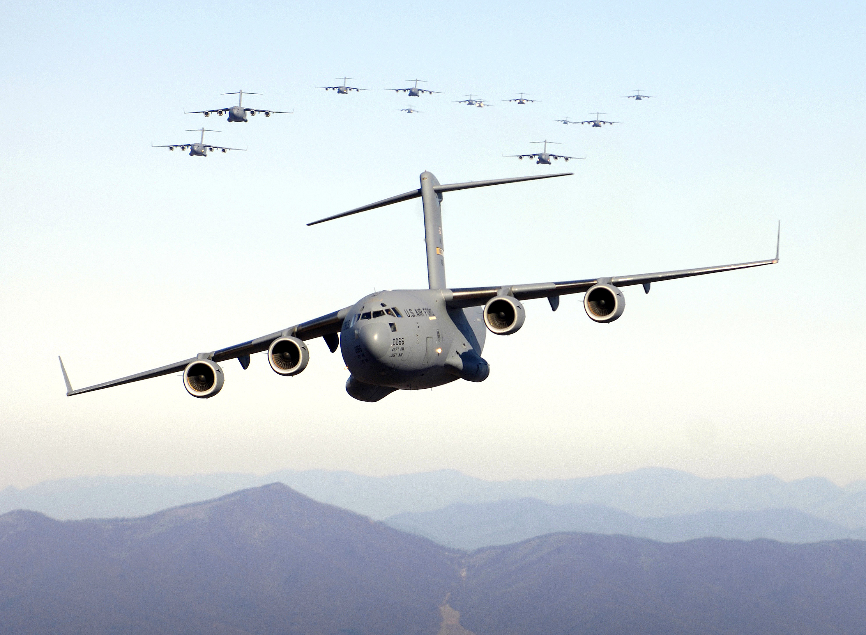 A formation of 17 C-17 Globemaster IIIs fly over the Blue Ridge Mountains in Virginia during low-level tactical training. (U.S. Air Force photo by Staff Sgt. Jacob Bailey)