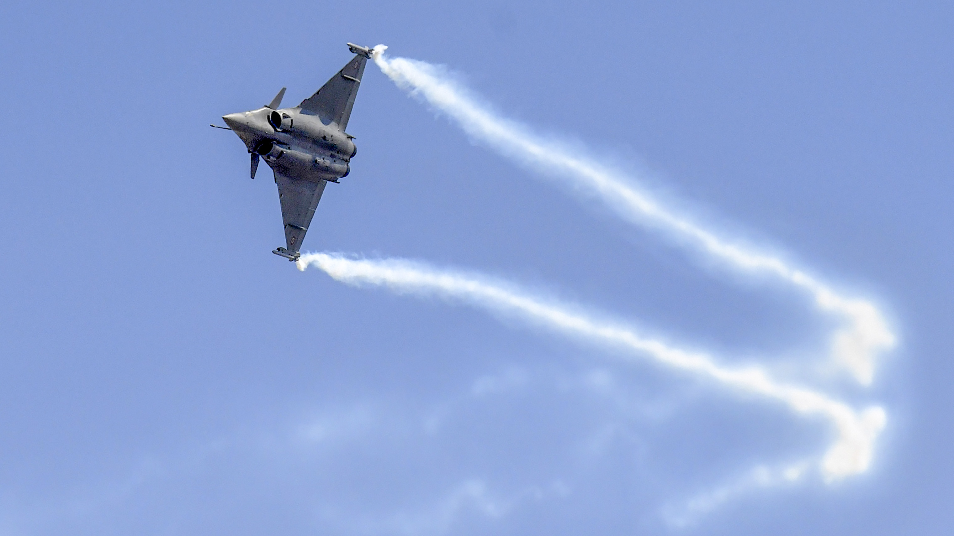 The controversial French-made Rafale fighter aircraft performs a maneuver during a rehearsal at the Yelahanka Air Force Station in Bangalore on February 18, 2019, ahead of the 12th edition of India's biennial international Air Show. - Three Rafale fighters participate in the biennial International Aero India Air Show from February 20 to 24, an official said on February 14. (MANJUNATH KIRAN/AFP/Getty Images)
