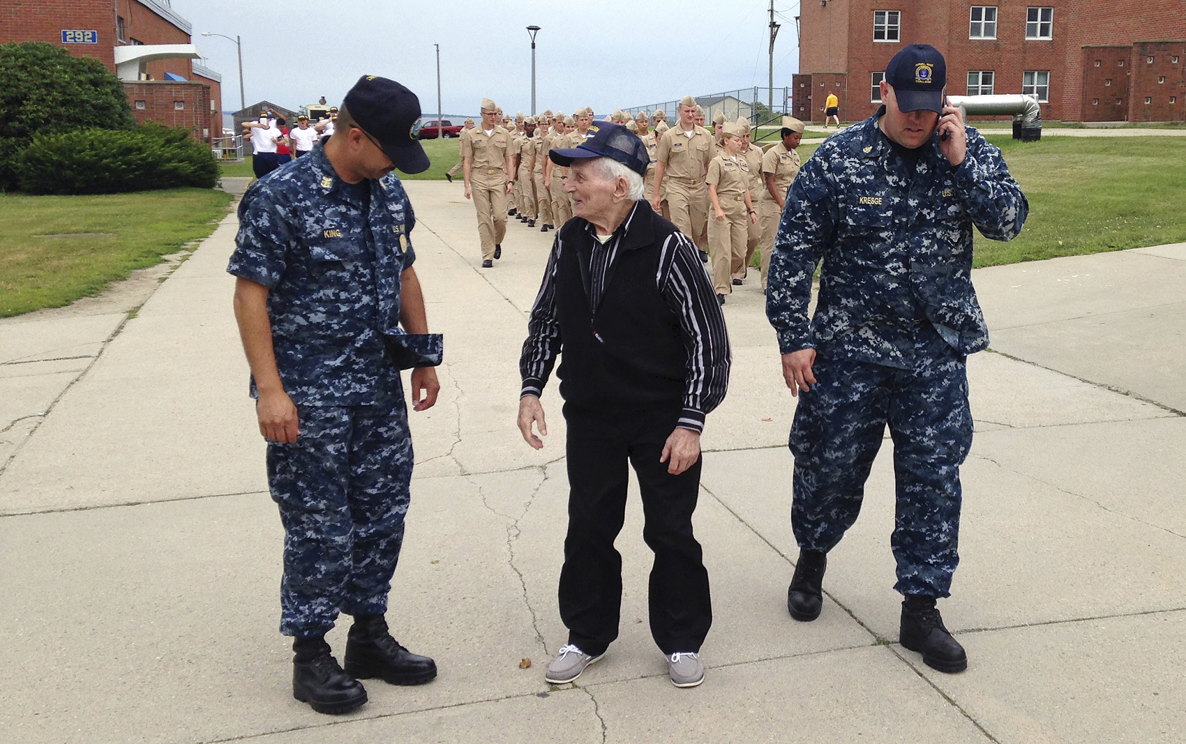 WWII veteran Edmund DelBarone, center, chats with Command Master Chief Paul King, left, during a tour at Naval Station Newport, in Newport, R.I., Thursday July 27, 2017. DelBarone, a 96-year-old World War II veteran, once dreamed of returning to a Navy installation to reminisce about his naval career, and help of a nonprofit it has become a reality. (Jennifer McDermott/AP)