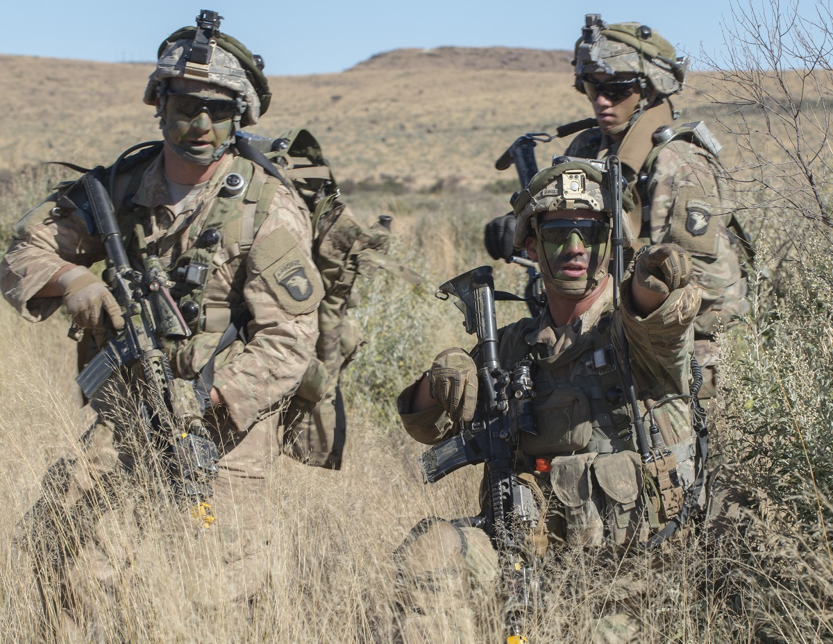 Staff Sgt. Donovan Sweet, a squad leader with the 101st Airborne Division, gives orders to his soldiers during an exercise in South Africa. The Army on Monday released the names of the soldiers moving up to sergeant and staff sergeant in October. (Sean Kimmons/Army)