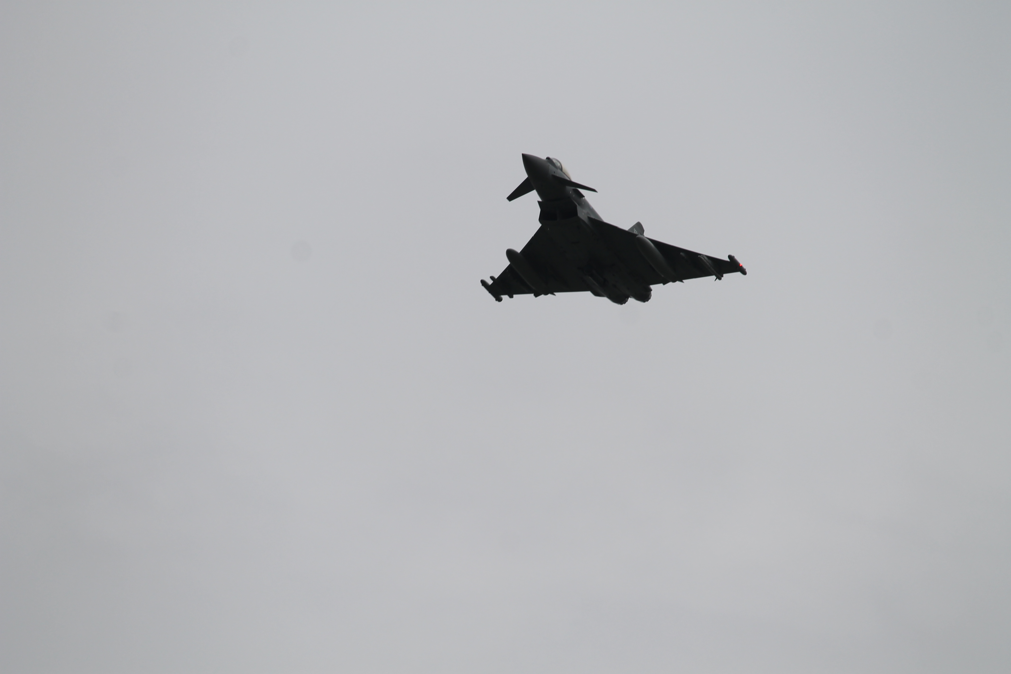 A Eurofighter Typhoon jet soars over the bridge on the Danube. (Jen Judson/Staff)