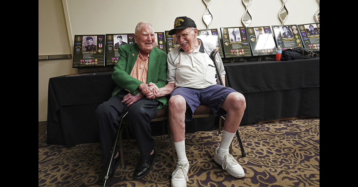Surviving members of the famed WWII Army unit Merrill's Marauders, David Allan, of Rockhill SC, left, and Robert Passanisi, of Lindenhurst NY, shake hands during a gathering of remaining members, family and history buffs, in New Orleans, Tuesday, Aug. 28, 2018. (Gerald Herbert/AP)