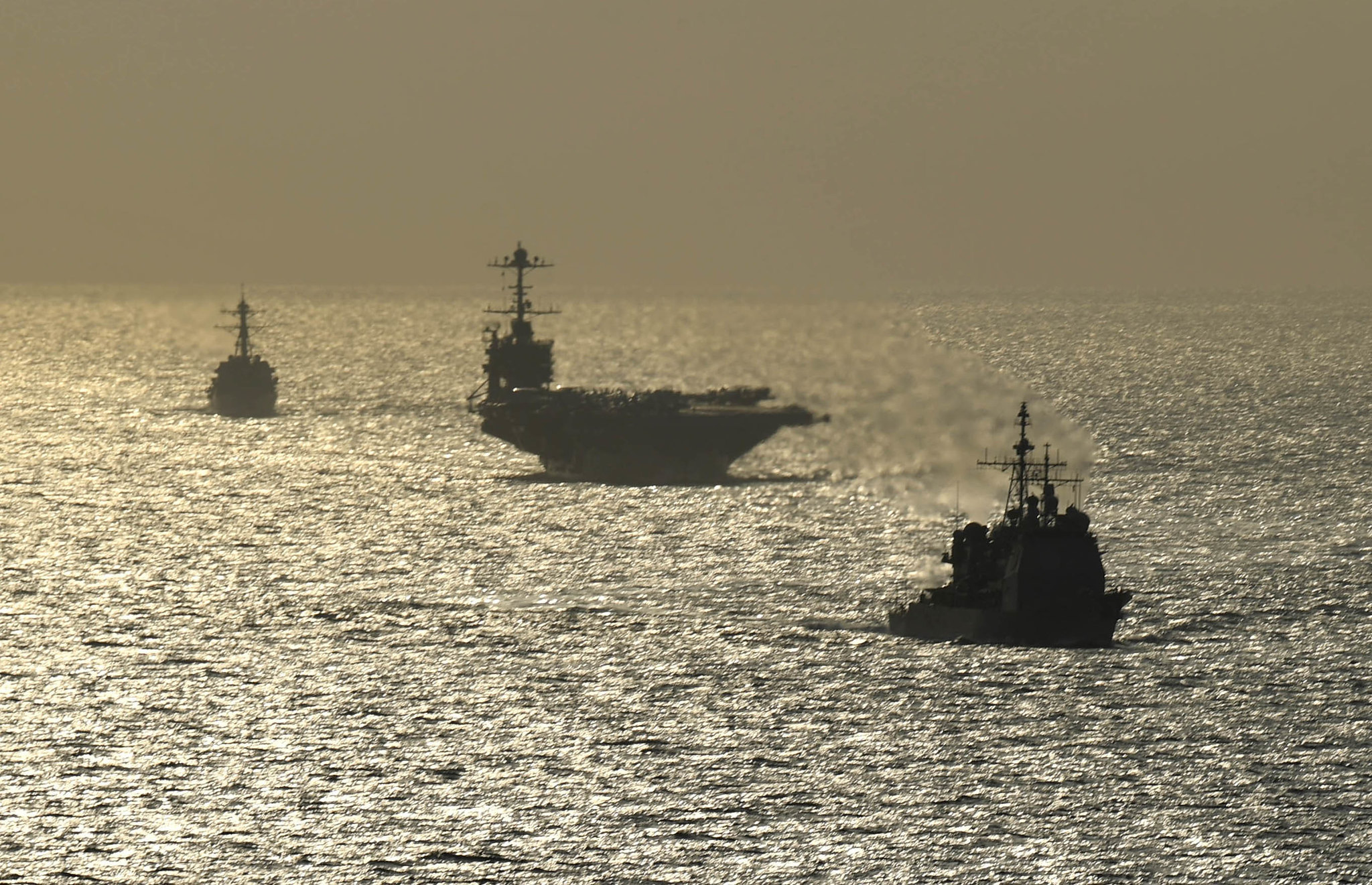 The Ticonderoga-class guided-missile cruiser USS Normandy (CG 60), front, the Nimitz-class aircraft carrier USS Harry S. Truman (CVN 75) and the Arleigh Burke-class guided-missile destroyer USS Lassen (DDG 82) transit the Atlantic Ocean on July 18, 2019. (Mass Communication Specialist 3rd Class Maxwell G. Higgins/Navy)