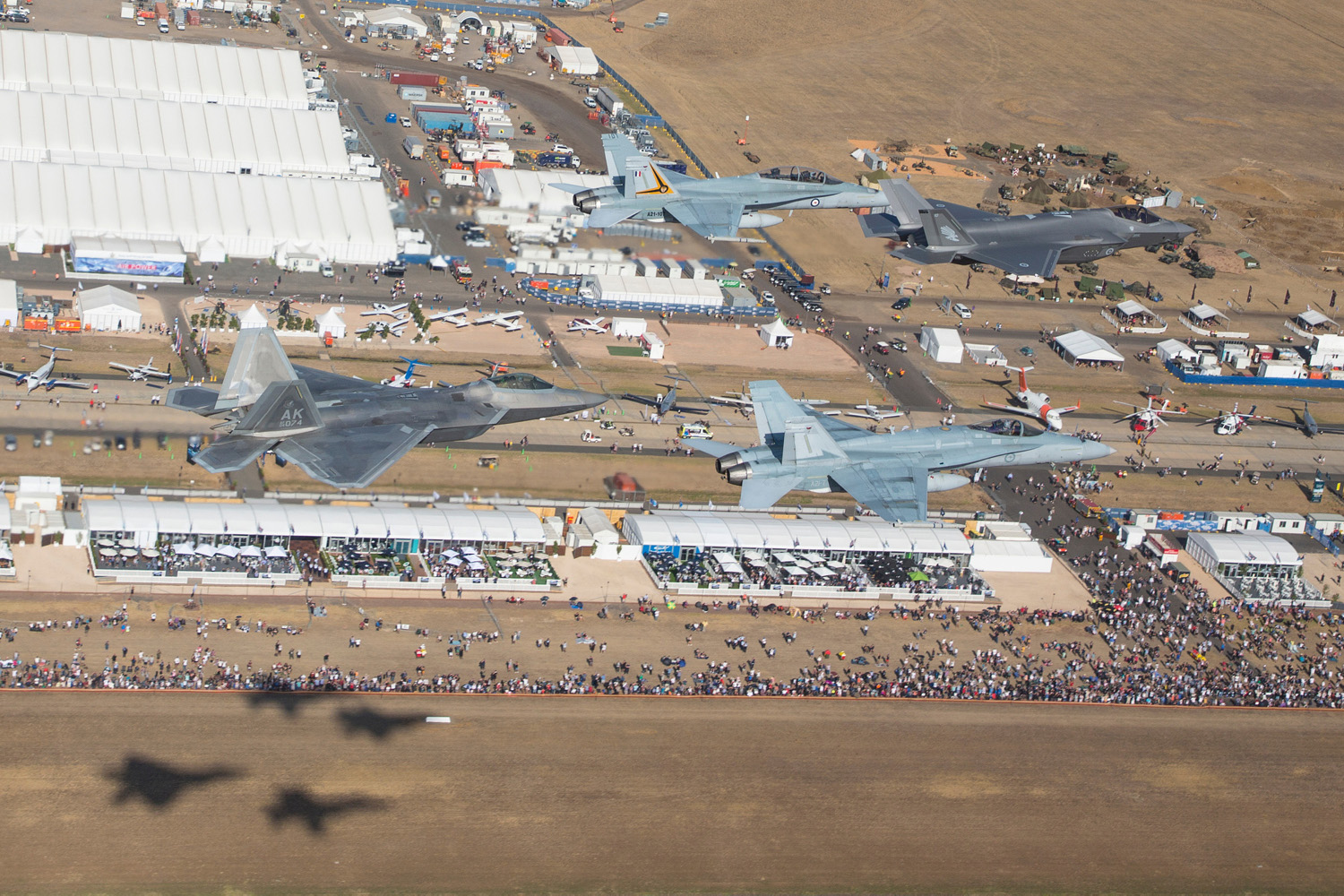 A special formation of a Royal Australian Air Force F-35A, two F/A-18A/B Hornets and a U.S. Air Force F-22A Raptor flies over the Avalon Airshow site during a joint display on March 1, 2019. (Commonwealth of Australia)