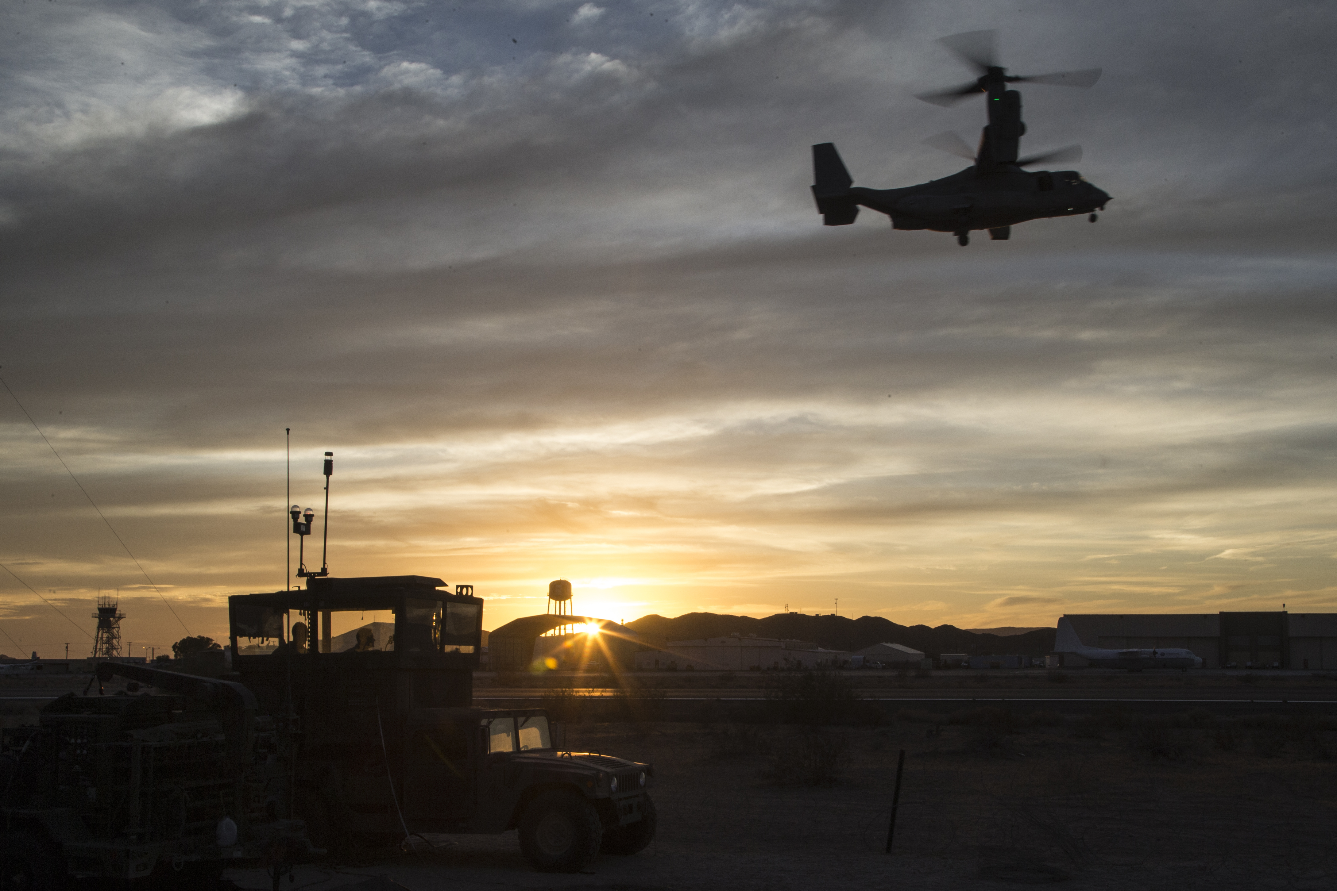 U.S. Marines assigned to Marine Aviation Weapons and Tactics Squadron One ensure safe runways for MV-22 Ospreys to land on during Weapons and Tactics Instructor Course (WTI) 1-18 at Yuma Proving Grounds, Ariz.. WTI is a seven-week training event hosted by MAWTS-1 cadre. (Sgt. Allison Lotz/Marine Corps)