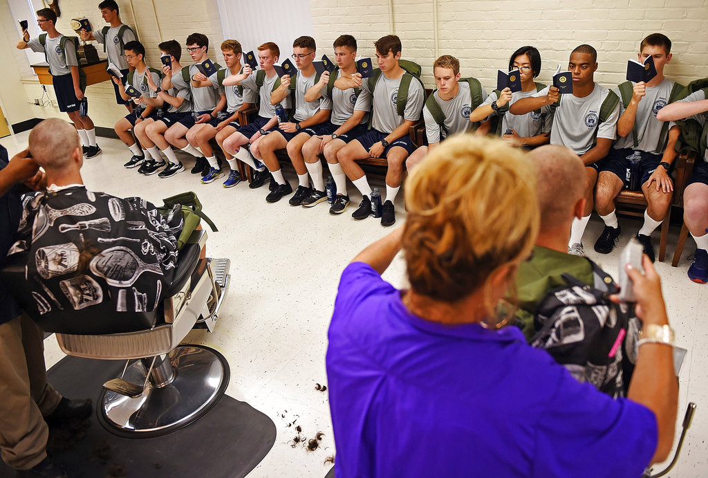 Members of the U.S. Coast Guard Academy Class of 2022 wait for their haircuts on Day 1 of Swab Summer on July 2, 2018 at the academy in New London, Conn. (Sean D. Elliot/The Day via AP)