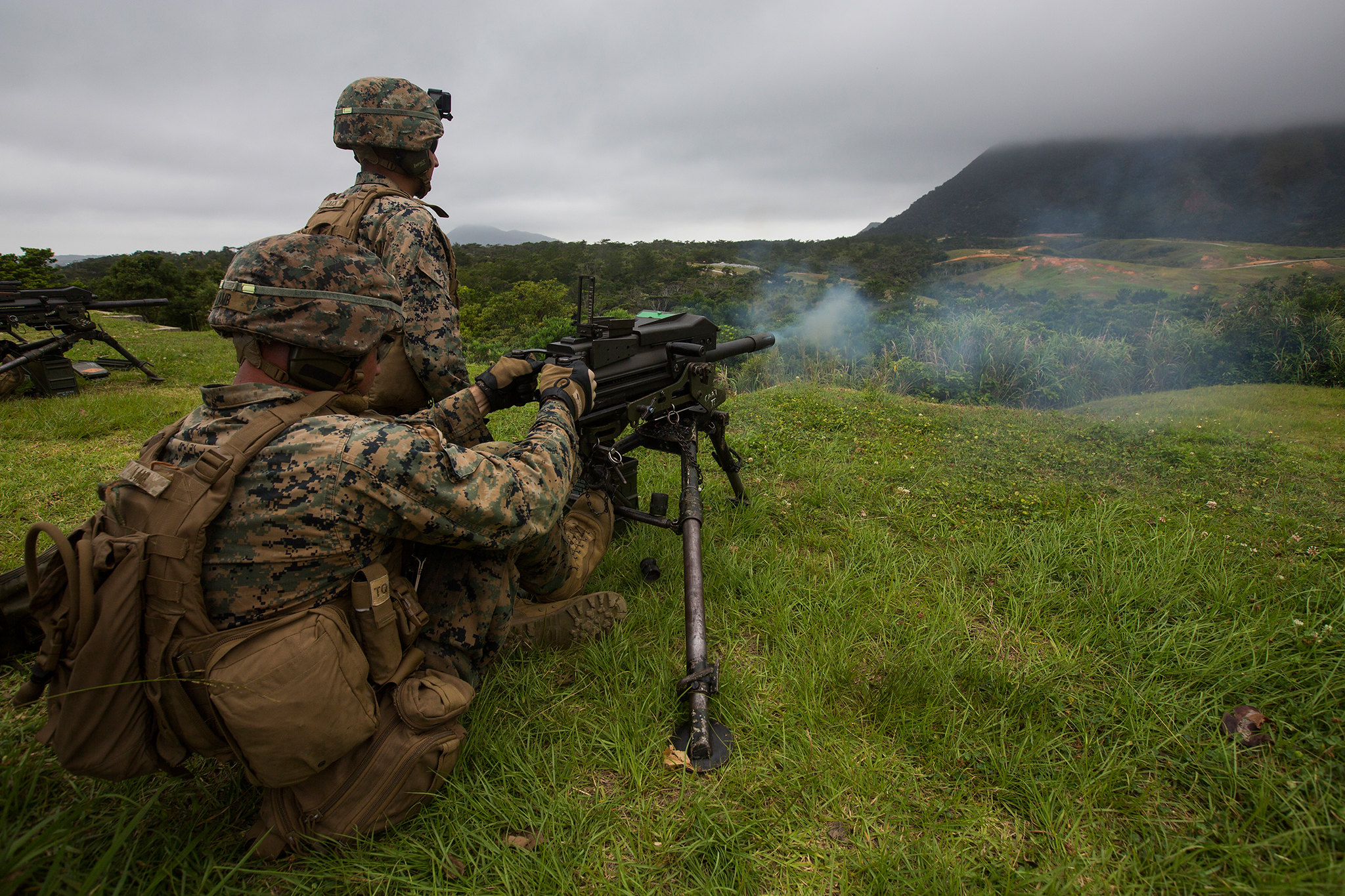 Marines fire a Mark 19 automatic grenade launcher during training at Camp Schwab, Okinawa, Japan, May 28, 2019. (Lance Cpl. Cameron E. Parks/Marine Corps)